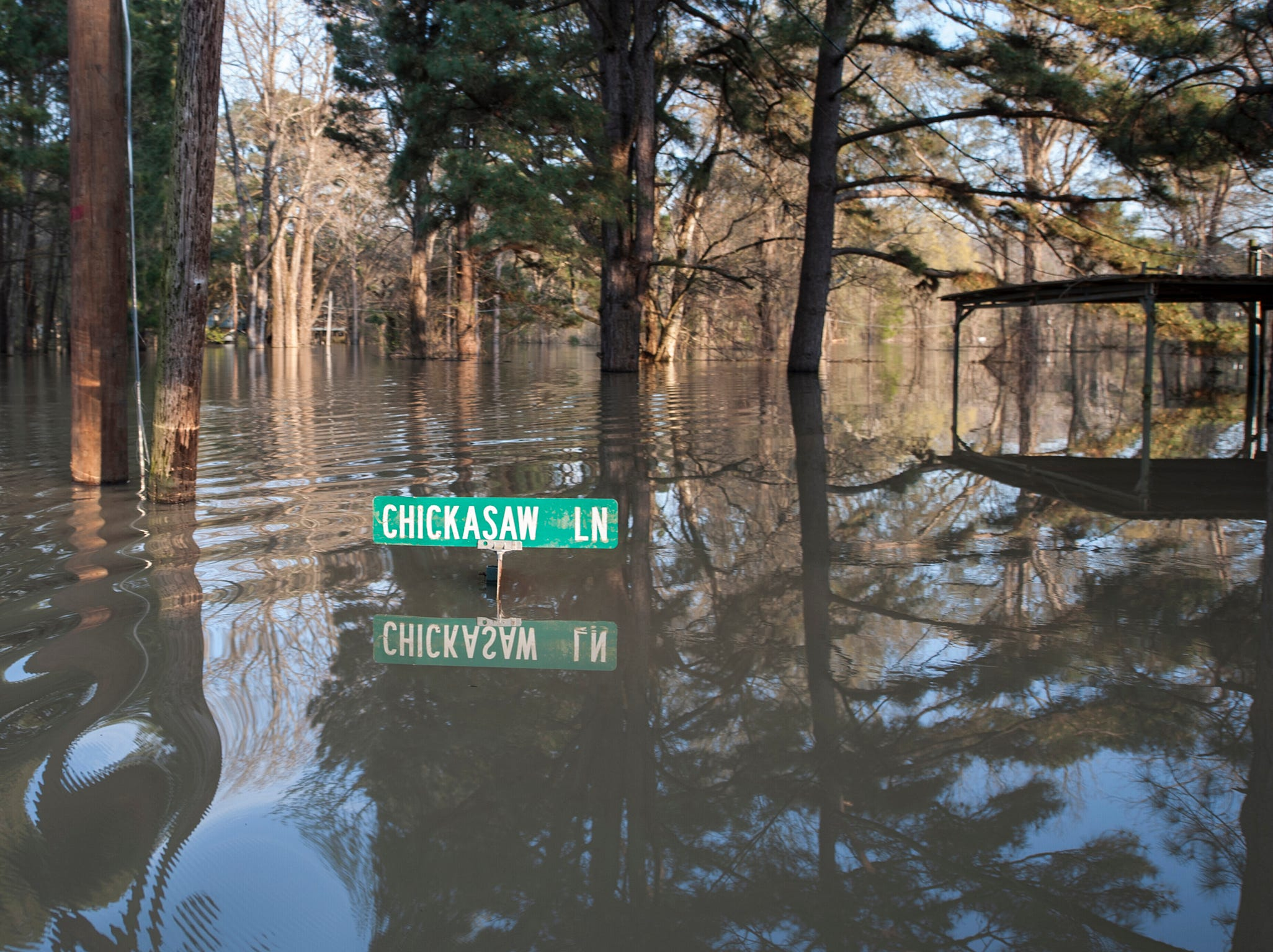 The sign indicating the intersection of Chickasaw Lane and Chickasaw Drive is barely above water in a Vicksburg neighborhood that has, way too often, seen flood damage from the Yazoo River.