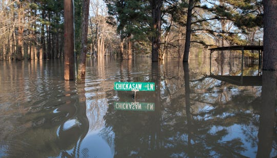 The sign indicating the intersection of Chickasaw Lane and Chickasaw Drive is barely above water in a Vicksburg neighborhood that has, way too often, seen flood damage from the Yazoo River. March 20, 2019