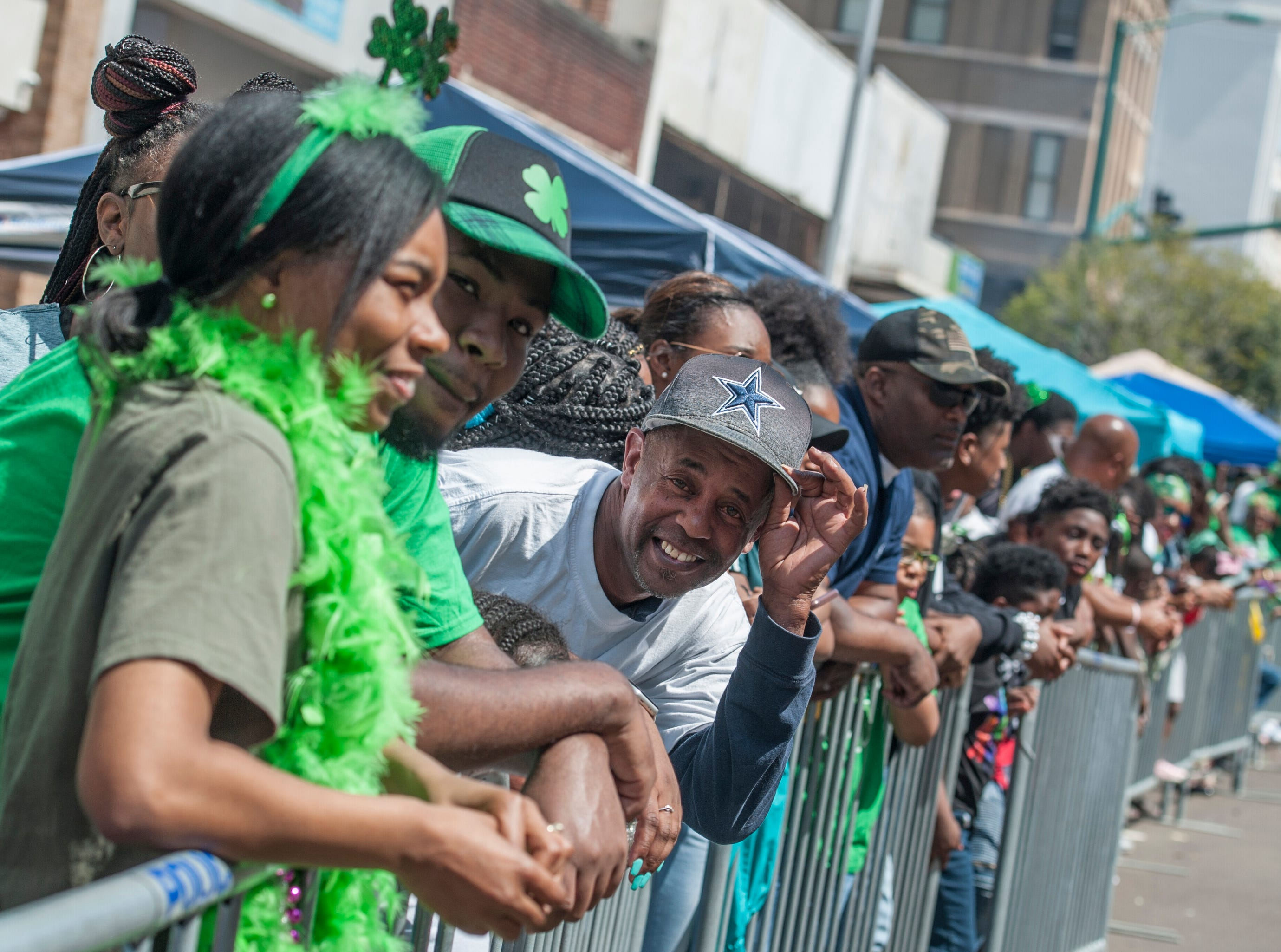 The crowd is in a good mood and ready as they wait for the start of the Hal's St. Paddy's Day Parade on Saturday, March 23, 2019,.