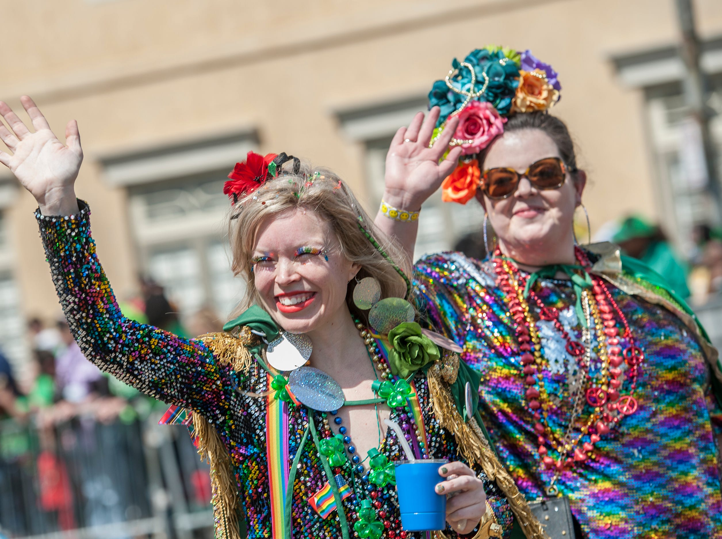 Wannabes Mary Etta Carner, left, of Clinton and Emily Routh of Jackson, with the Nugget League, march in Hal's St. Paddy's Day Parade in Jackson, Saturday, March 23, 2019.