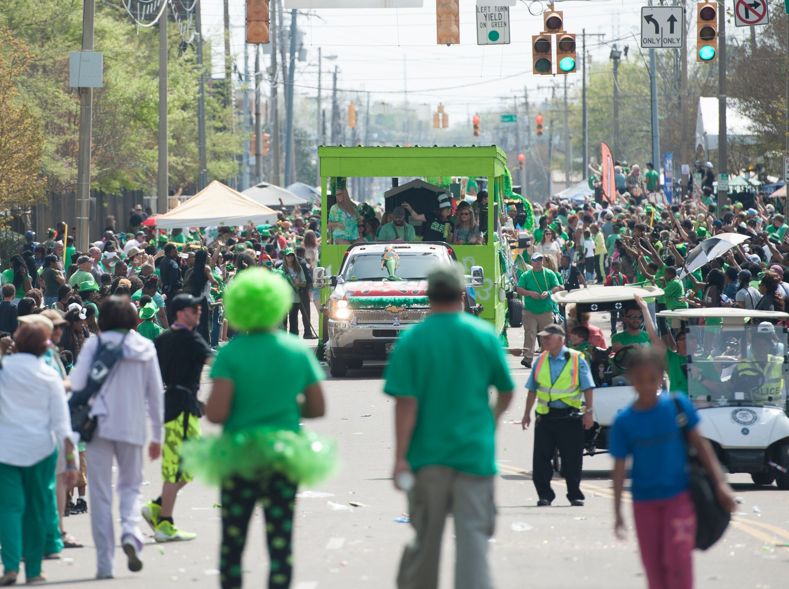 Authorities get the crowd back as they encroach on the parade route along West Street Saturday, March, 23, 2019. Hal's St. Paddy's Day Parade participants met an enthusiastic crown along the downtown route.