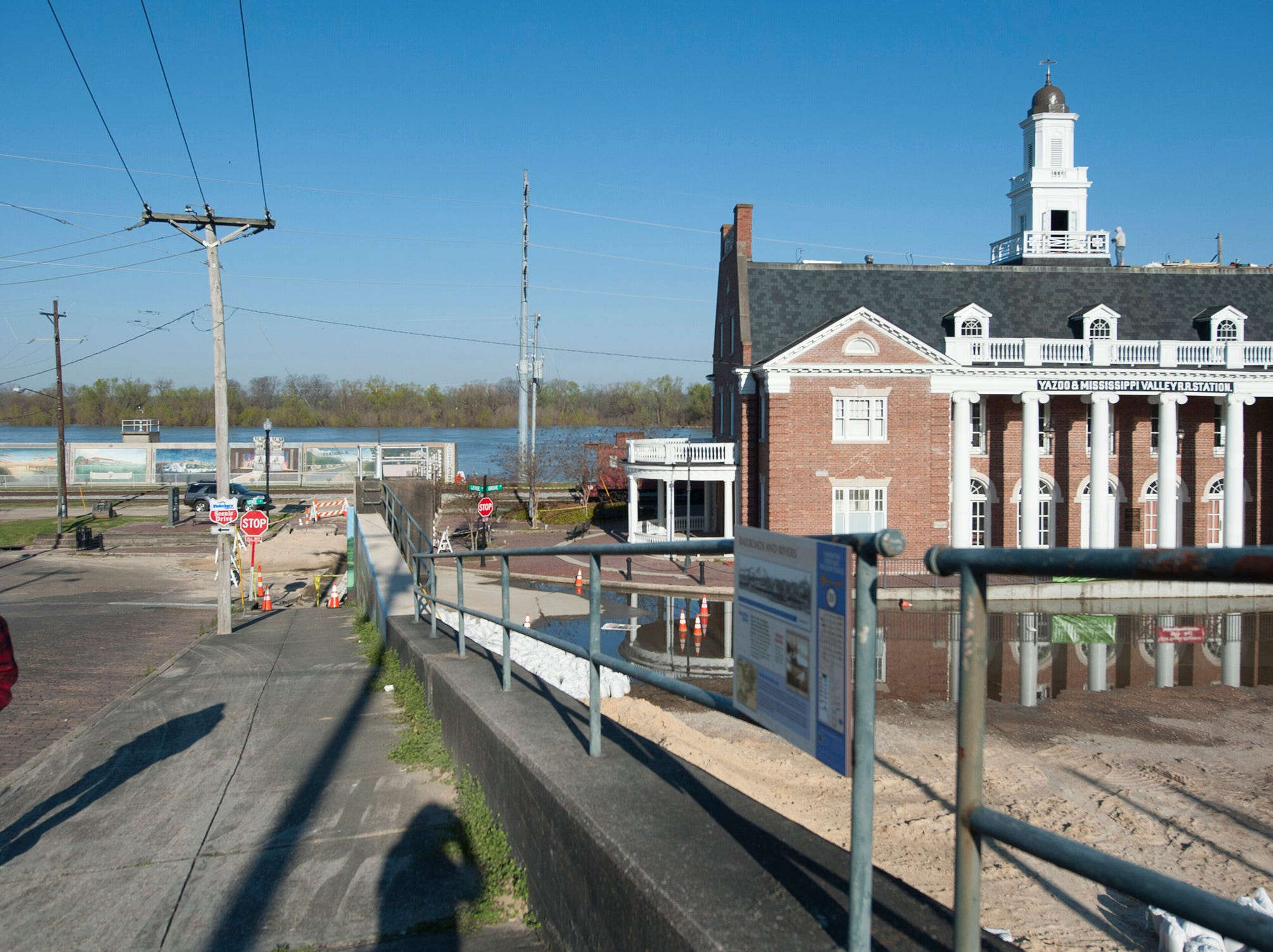 In the early morning of March 19, 2019, the high waters of the Yazoo River are visible behind the Old Depot Museum in Vicksburg. In the 2011 flood, over five feet of water got into the museum.