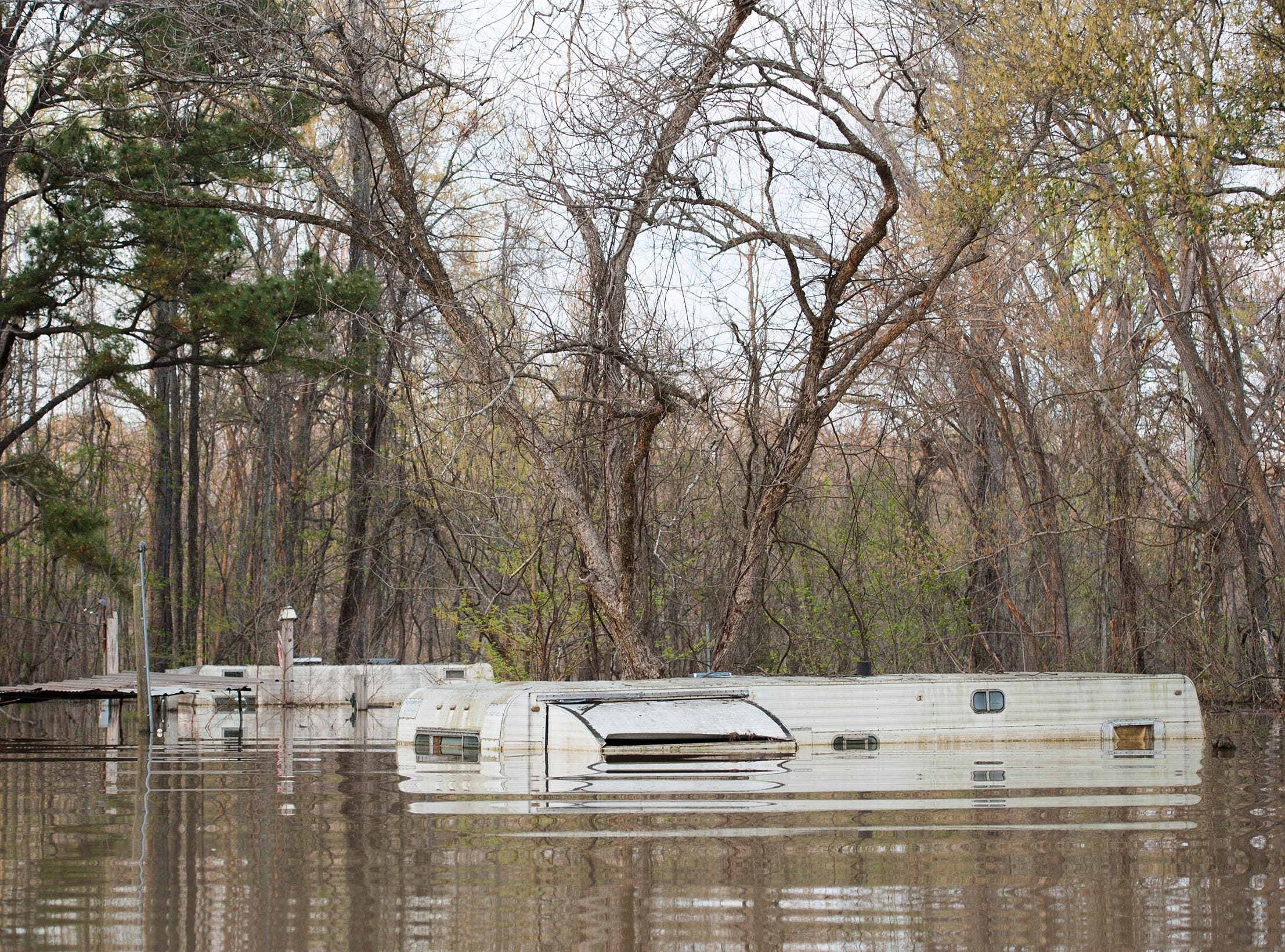 Almost surely a total loss, flood waters of the Yazoo River nearly reach to top of campers in Chickasaw in Vicksburg, March 19, 2019.