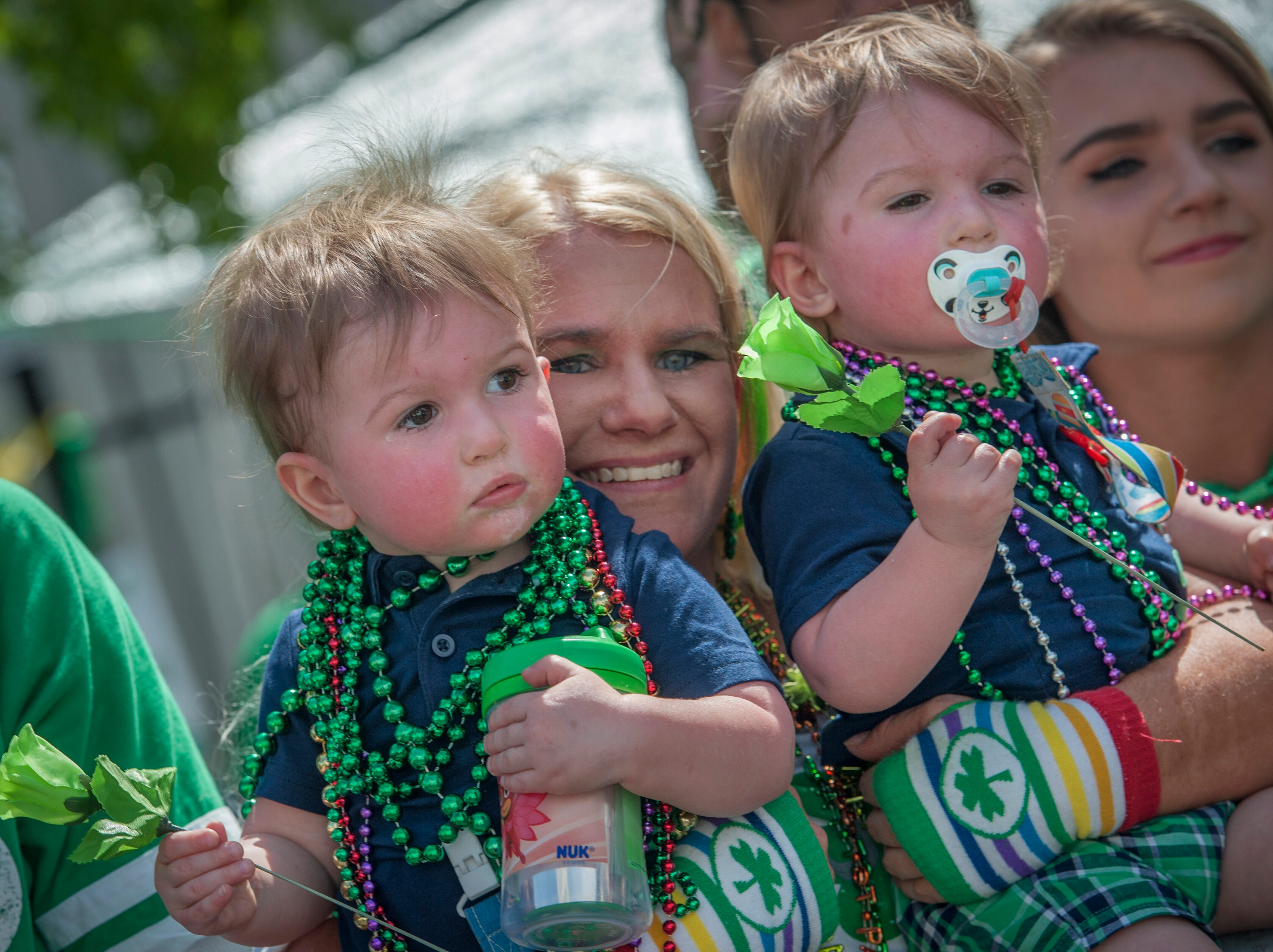 Amber Quick of Brandon, with Lucas, left, and Gage, right, enjoys the experience of her identical 1-year-old twin sons' first parade during Hal's St. Paddy's Day Parade in Jackson, Saturday, March 23, 2019.