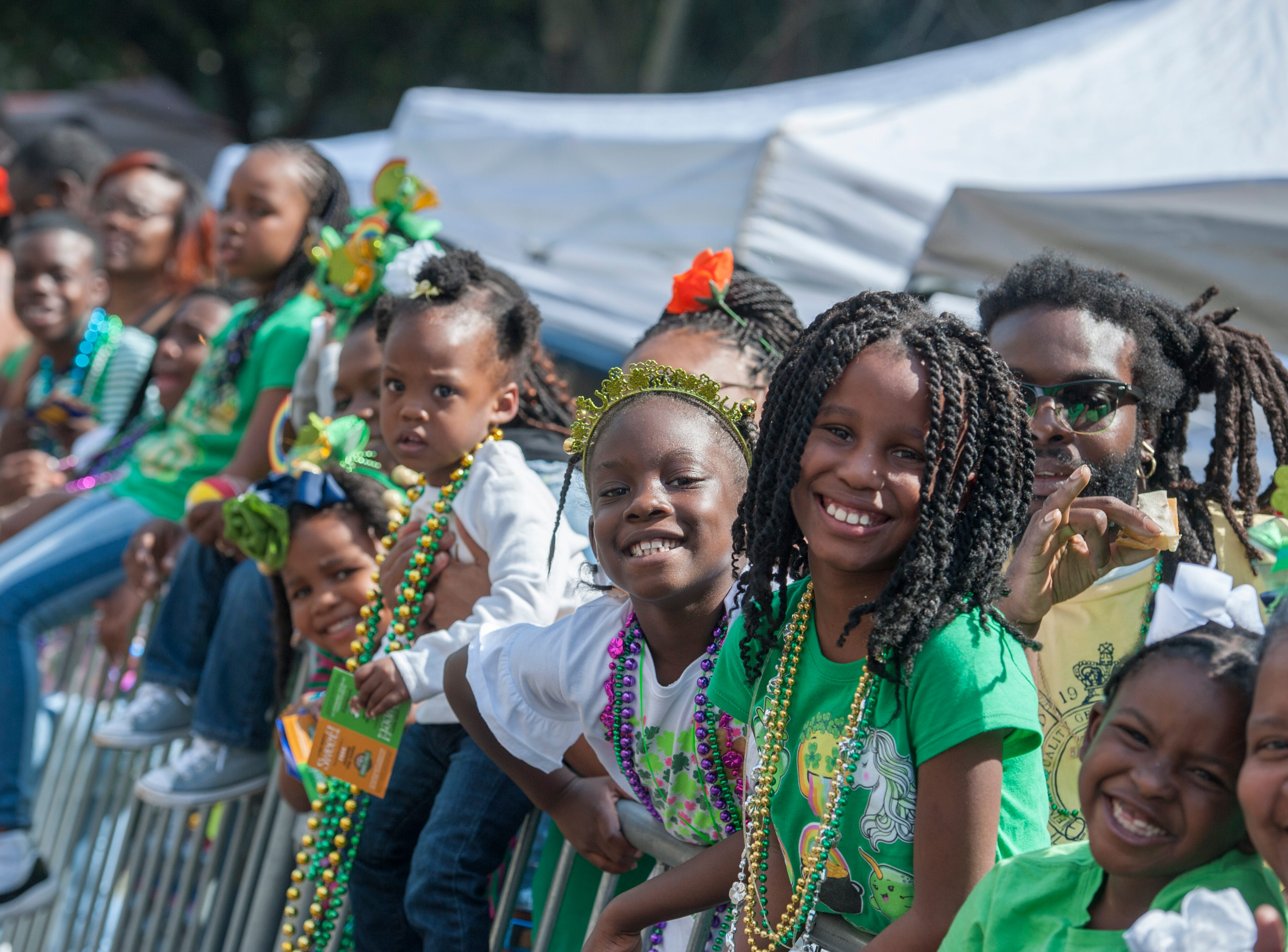 Smiling young faces at Hal's St. Paddy's Day Parade show an annual tradition in the making.