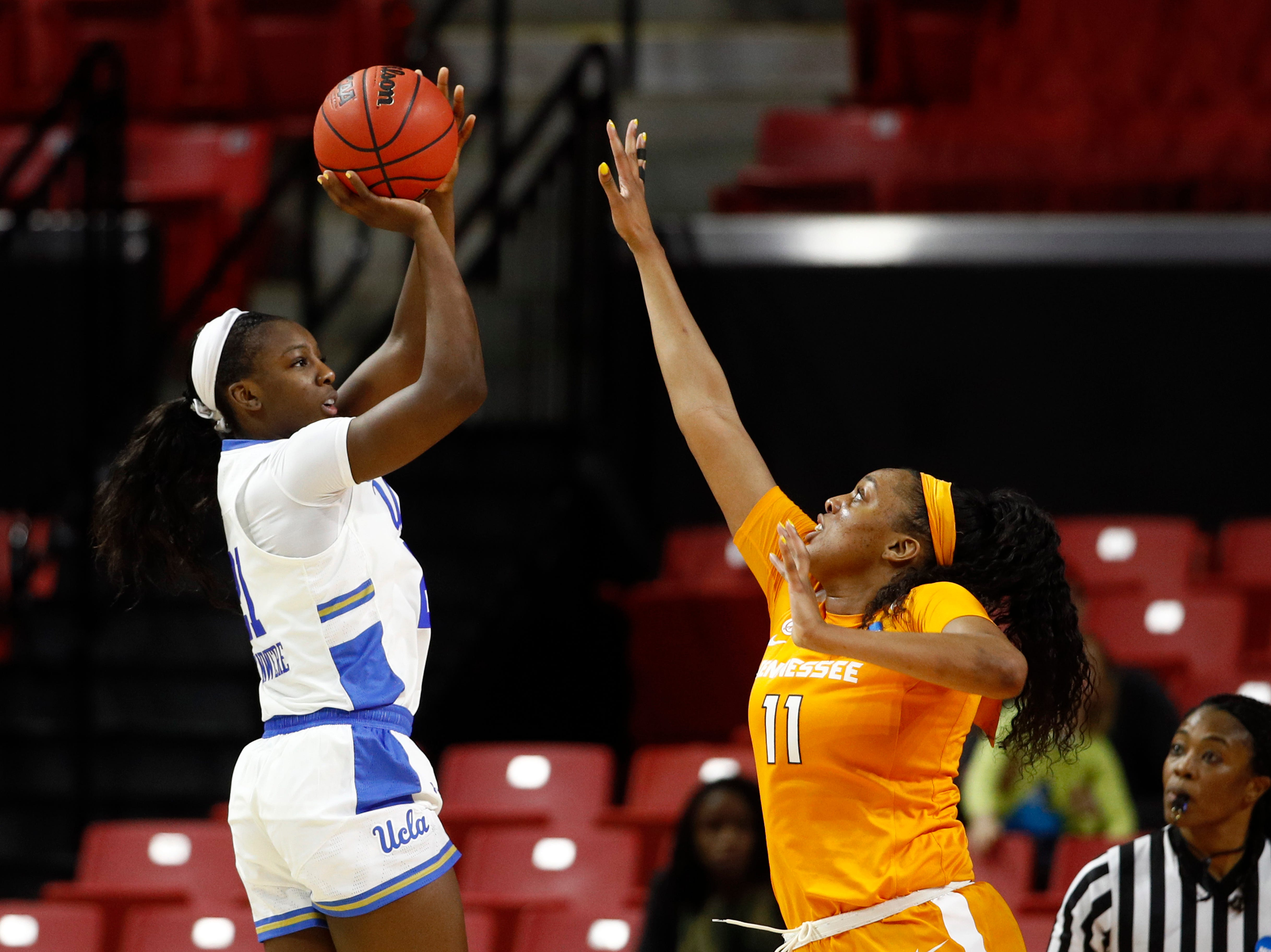 UCLA forward Michaela Onyenwere, left, shoots over Tennessee center Kasiyahna Kushkituah in the second half of a first-round game in the NCAA women's college basketball tournament, Saturday, March 23, 2019, in College Park, Md. Onyenwere contributed a game-high 22 points im UCLA's 89-77 win.