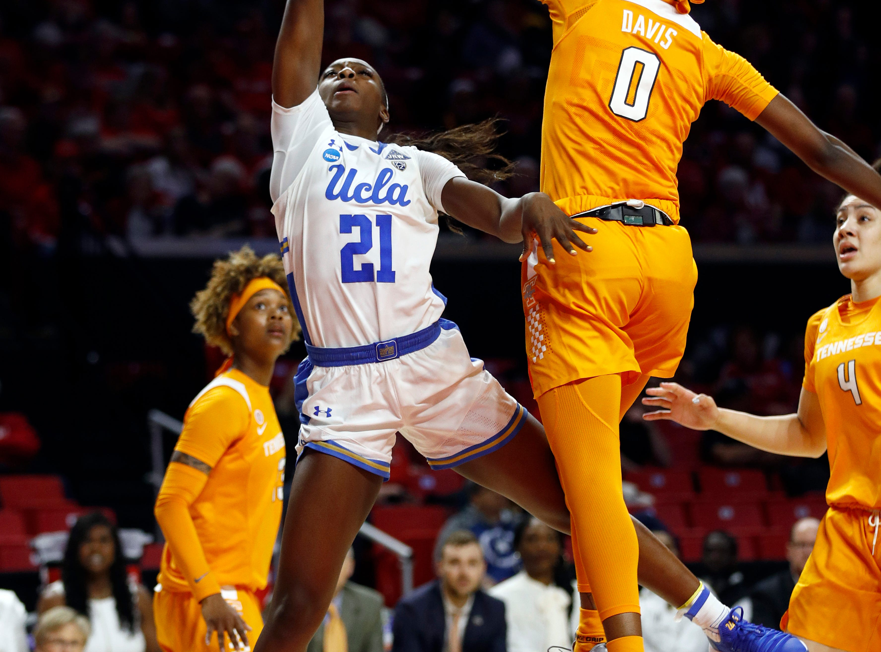 UCLA forward Michaela Onyenwere (21) shoots over Tennessee guard Rennia Davis in the first half of a first-round game in the NCAA women's college basketball tournament, Saturday, March 23, 2019, in College Park, Md.