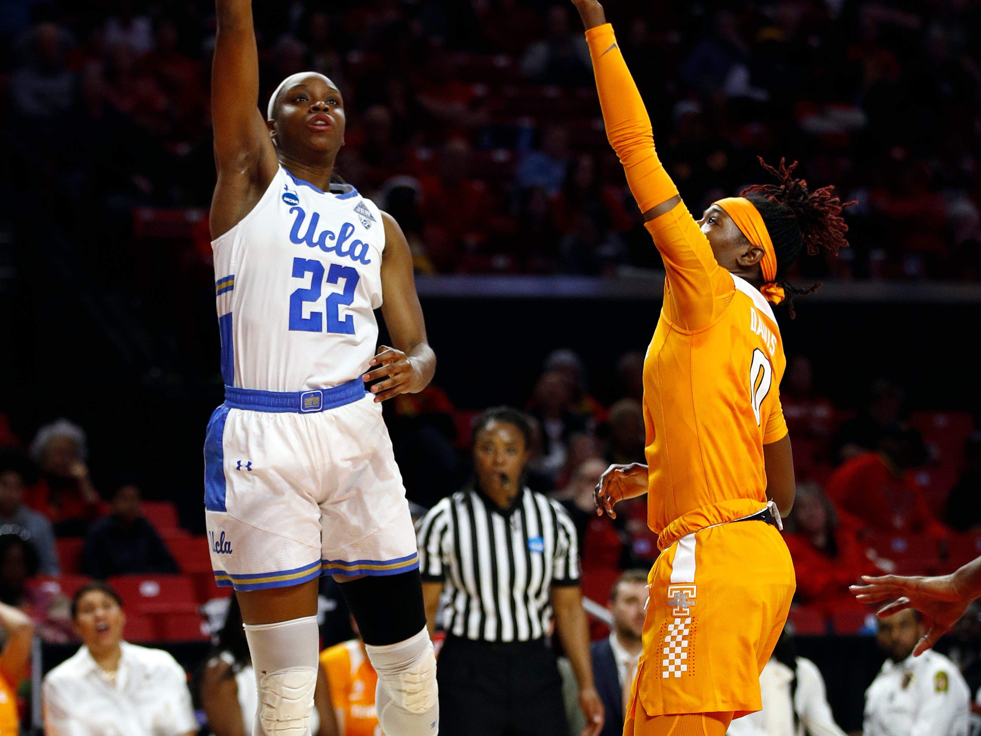 UCLA guard Kennedy Burke, left, shoots over Tennessee guard Rennia Davis in the first half of first-round game in the NCAA women's college basketball tournament, Saturday, March 23, 2019, in College Park, Md.