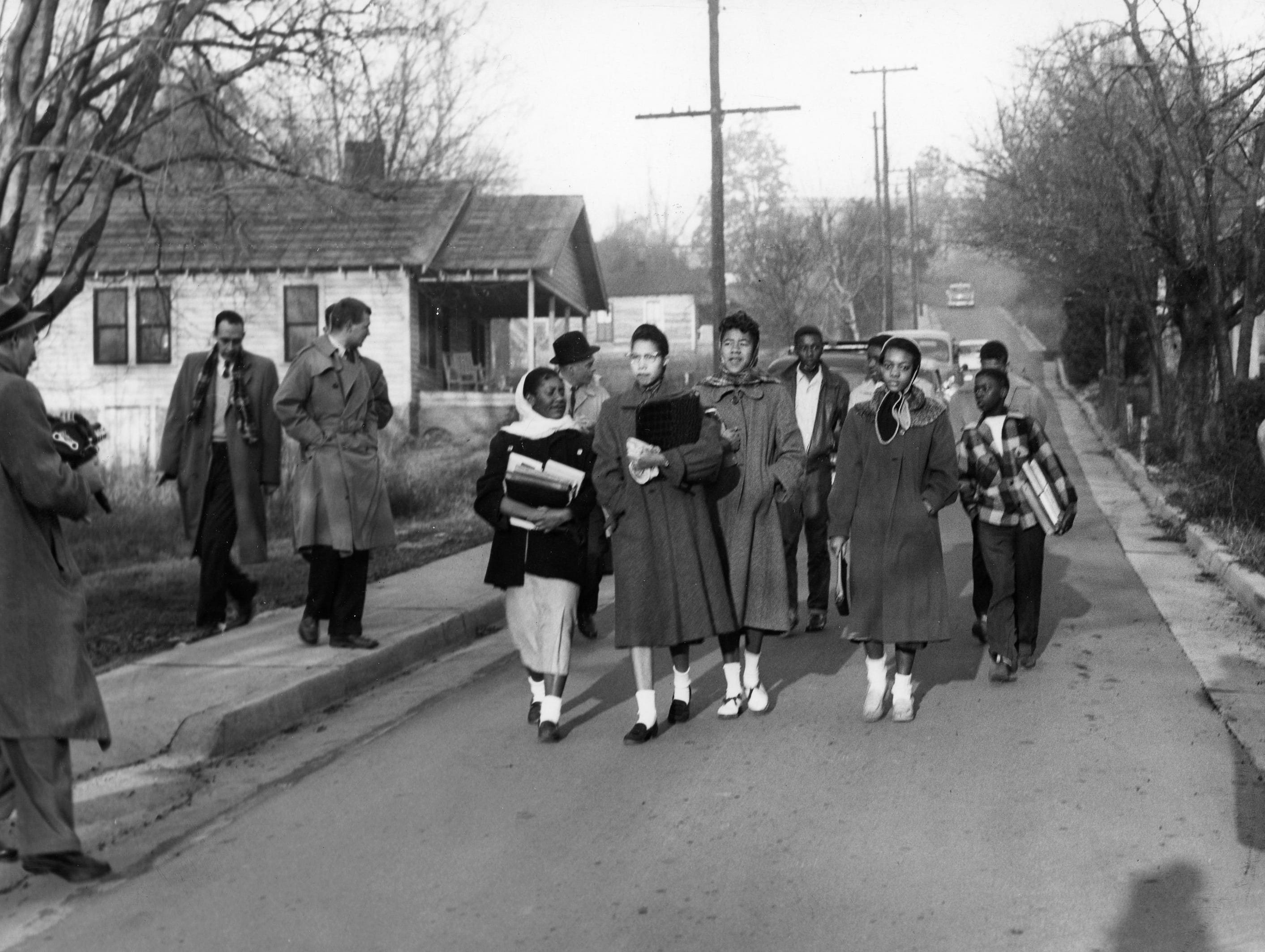Members of the Clinton 12 walk to Clinton High School in December 1956 after unrest flared again. Dated: Dec. 10, 1956.
