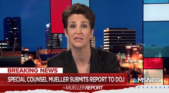MSNBC's Rachel Maddow stopped trout fishing to report on Robert Mueller from the University of Tennessee with the Knoxville skyline in the background on March 22, 2019.