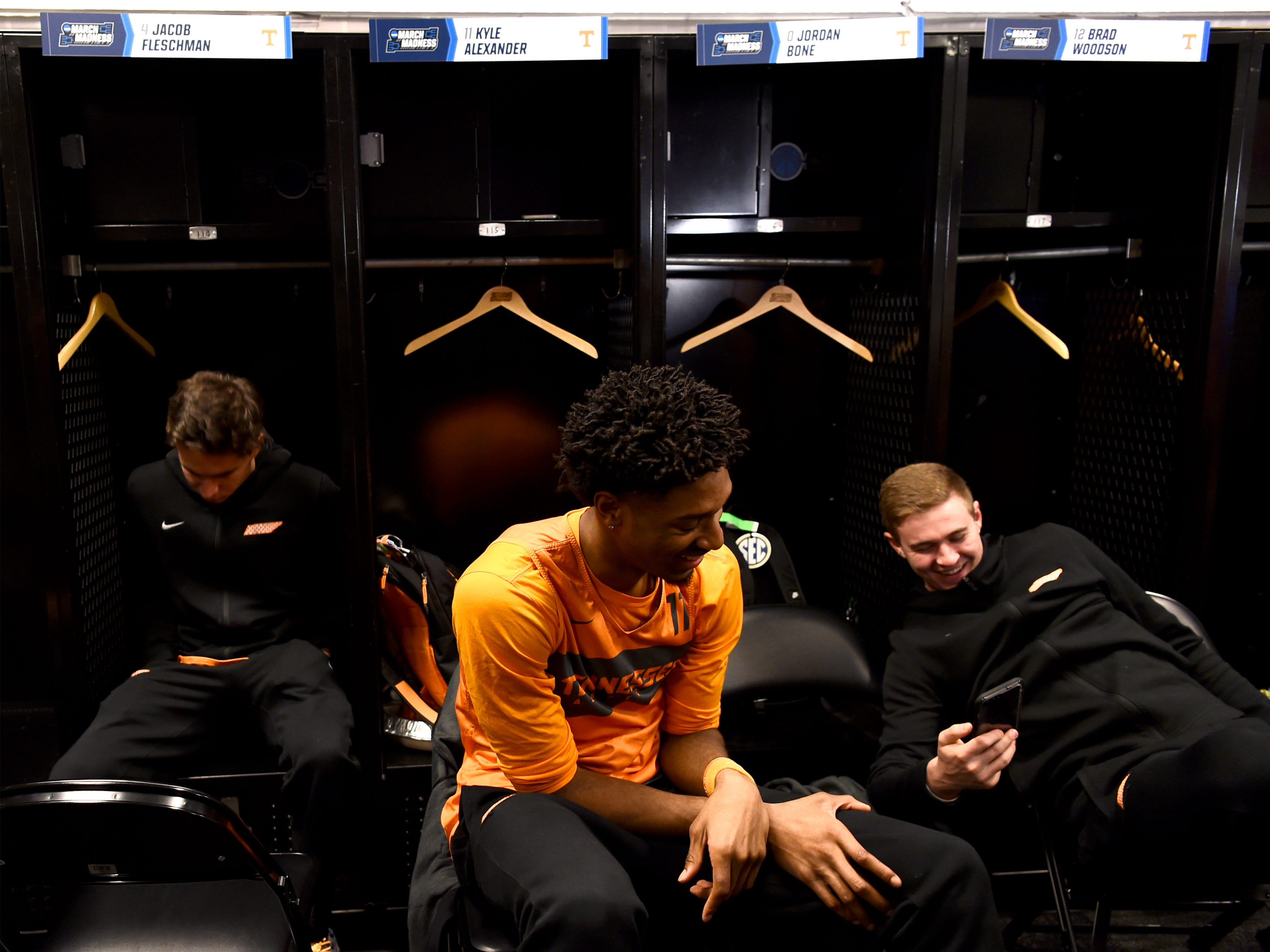 Tennessee forward Kyle Alexander (11) and Tennessee guard Brad Woodson (12) laugh in the locker room during media availability on Saturday, March 23, 2019, before the Tennessee Volunteers and Iowa Hawkeyes compete against one another in the second round of the NCAA Tournament held at Nationwide Arena in Columbus, Ohio, on Sunday, March 24, 2019.