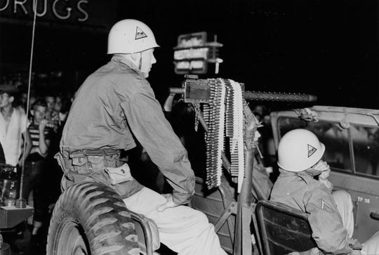 A jeep with mounted machine gun patrols the street in Clinton as a mob of demonstrators attempted to begin a third night of riots in the East Tennessee Town. Dated: Sep. 3, 1956.