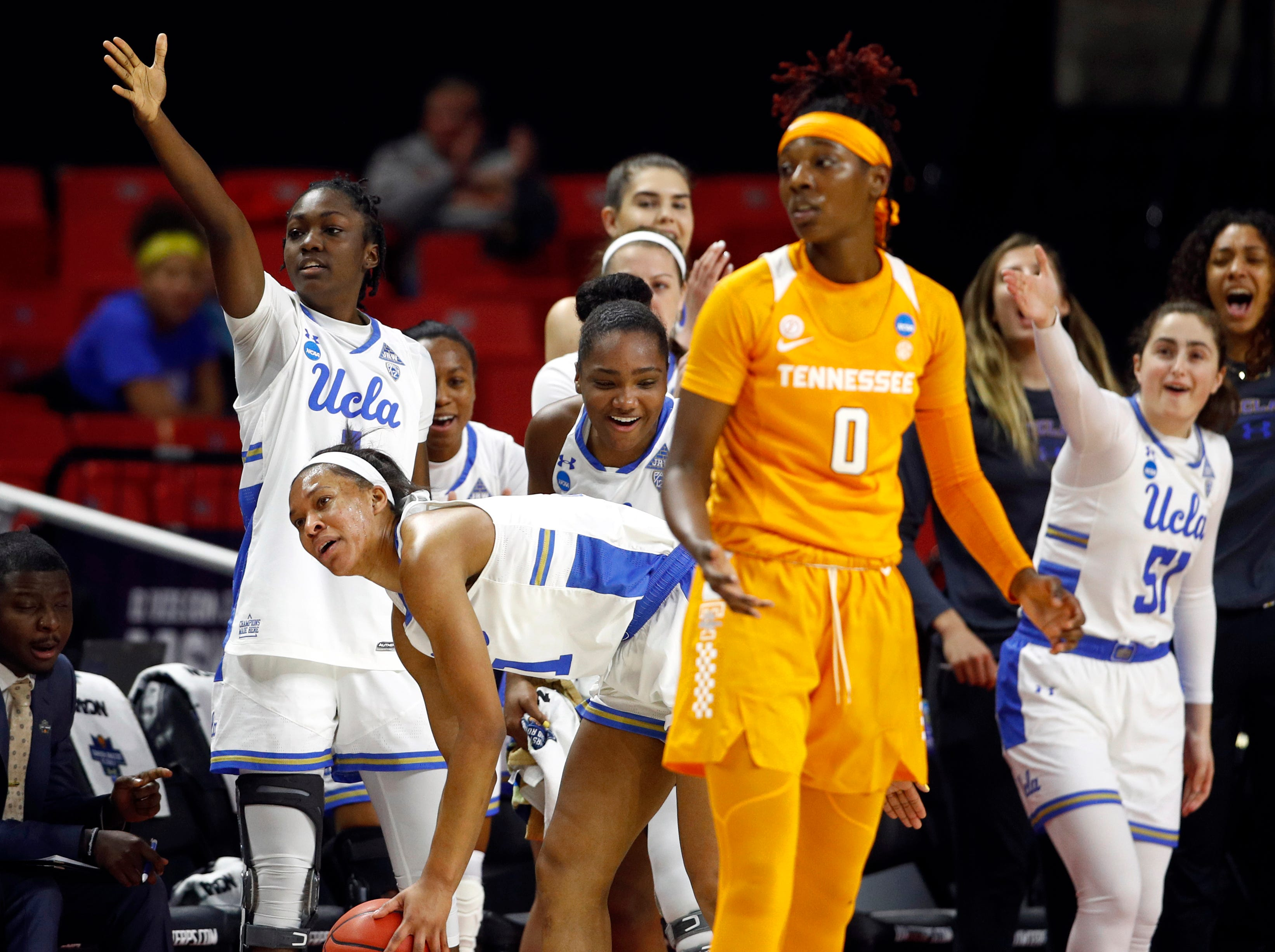 UCLA players celebrate after Tennessee guard Rennia Davis (0) was unable to keep the ball in bounds and turned over possession in the first half of a first-round game in the NCAA women's college basketball tournament, Saturday, March 23, 2019, in College Park, Md.