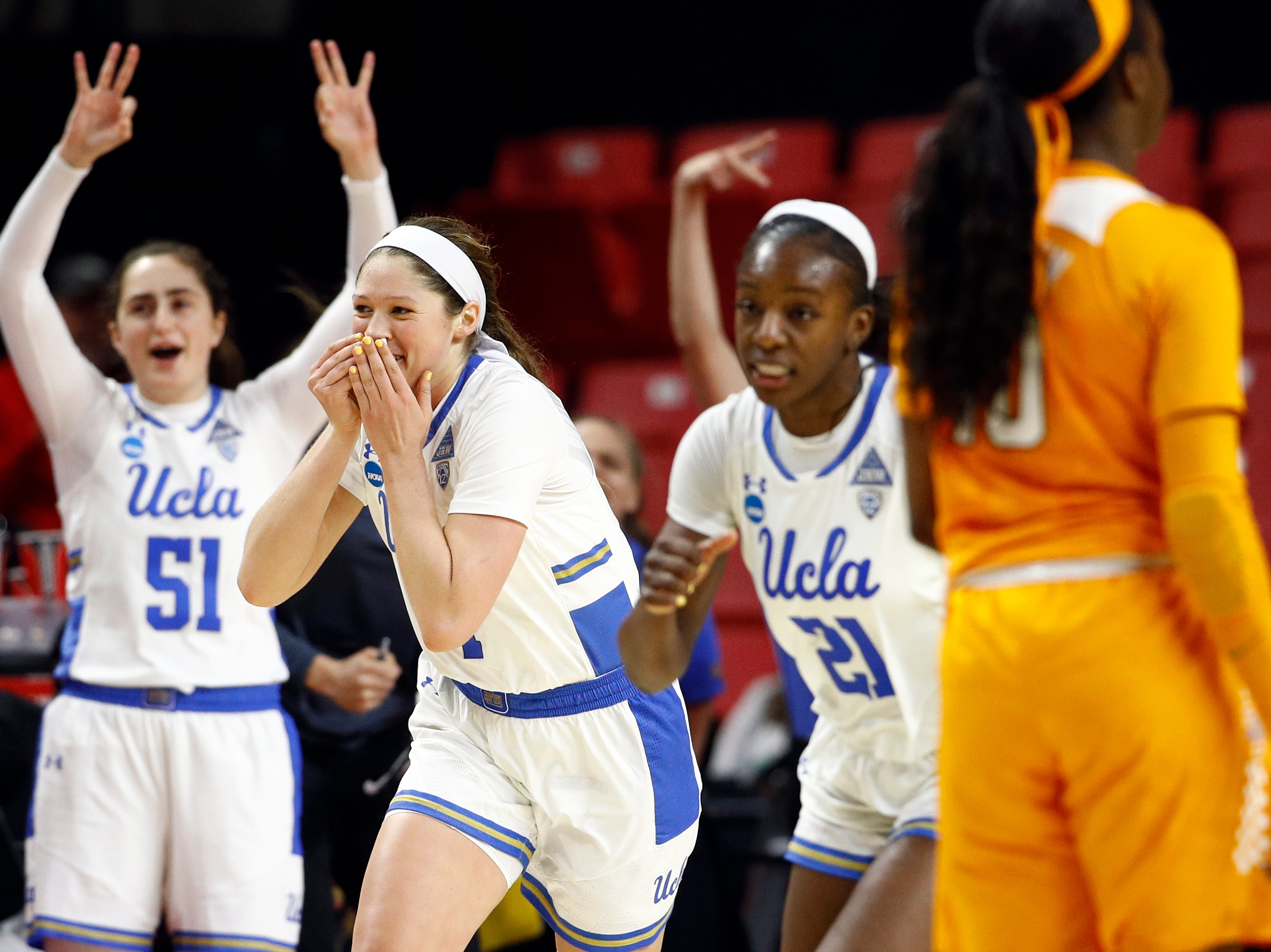 UCLA guard Lindsey Corsaro, second from left, reacts after making a 3-pointer in the second half of a first-round game against Tennessee in the NCAA women's college basketball tournament, Saturday, March 23, 2019, in College Park, Md. UCLA won 89-77.