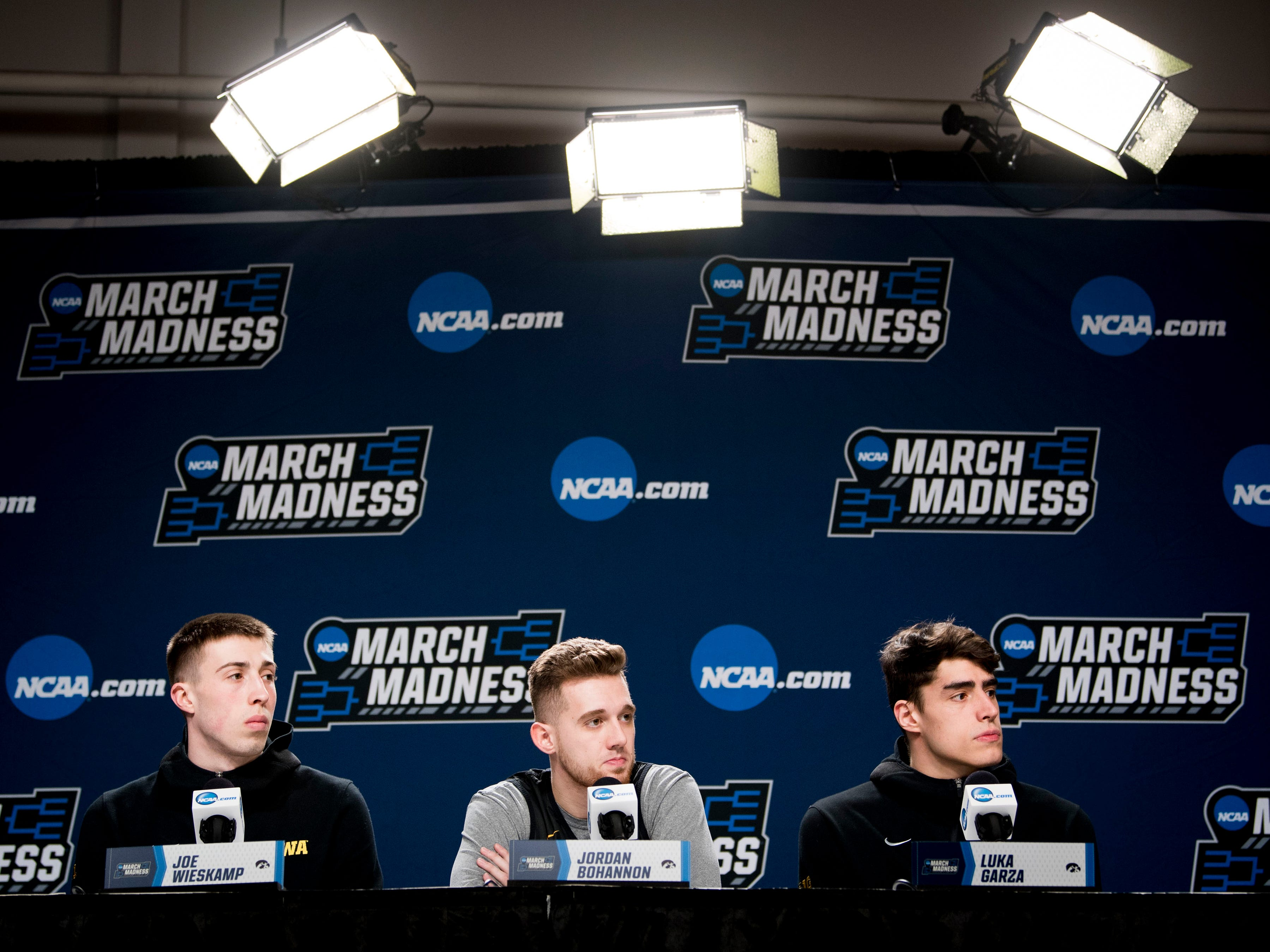 From left, Iowa's Joe Wieskamp, Jordan Bohannon and Luka Garza speak at a press conference on Saturday, March 23, 2019, before the Tennessee Volunteers and Iowa Hawkeyes compete against one another in the second round of the NCAA Tournament held at Nationwide Arena in Columbus, Ohio on Sunday, March 24, 2019.
