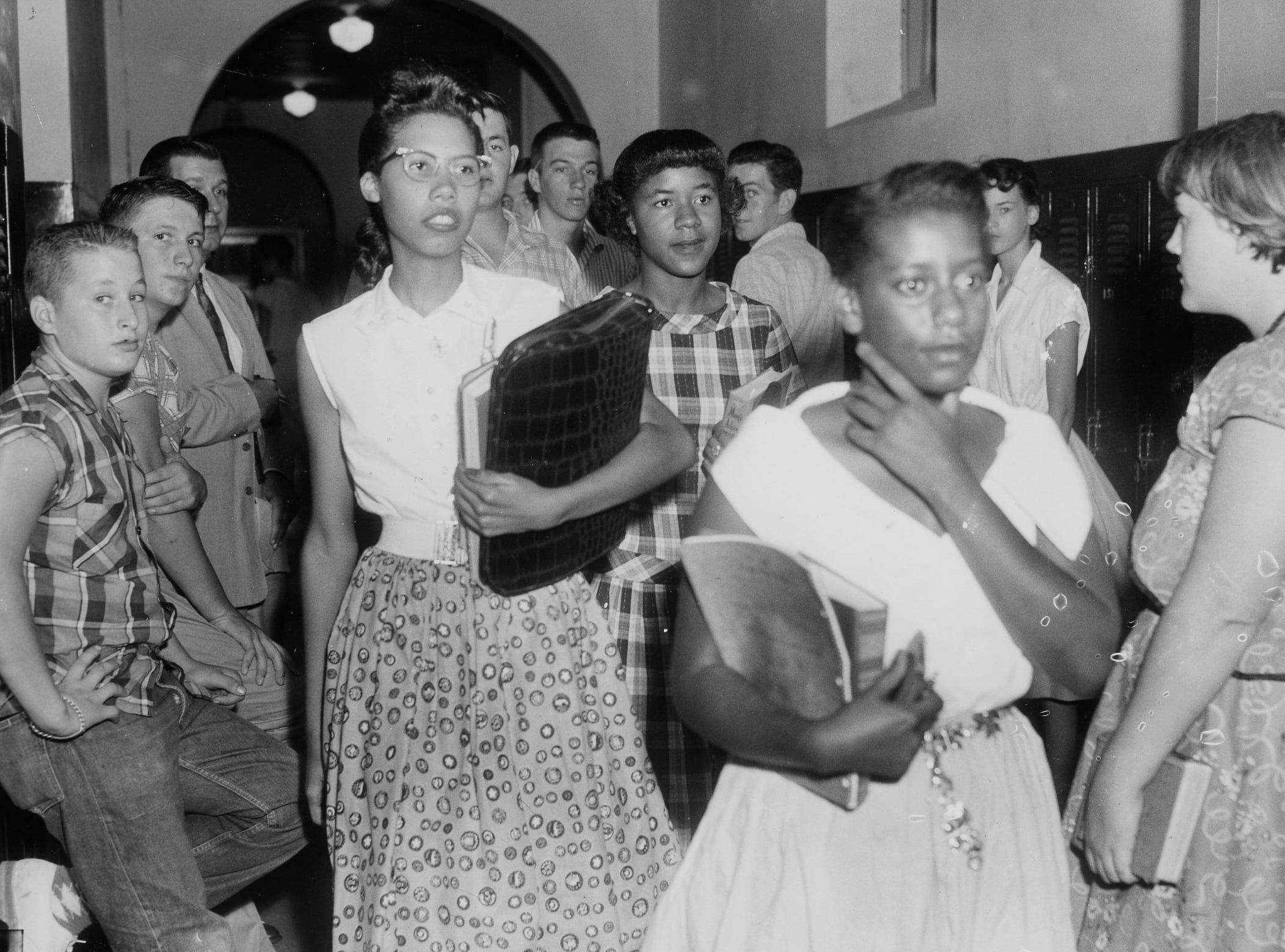 "Black students at Clinton High School pass through the corridor on the was to class as another demonstration against integration took place in the form of ""tomato throwing."" Three students were arrested. Dated: Aug. 30, 1956."