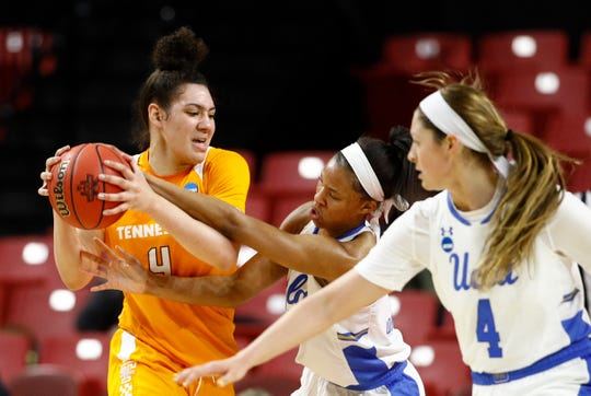 Tennessee forward Mimi Collins, left, tries to protect the ball as she is pressured by UCLA forward Lajahna Drummer, center, and guard Lindsey Corsaro in the first half of first-round game in the NCAA women's college basketball tournament, Saturday, March 23, 2019, in College Park, Md. UCLA won 89-77.