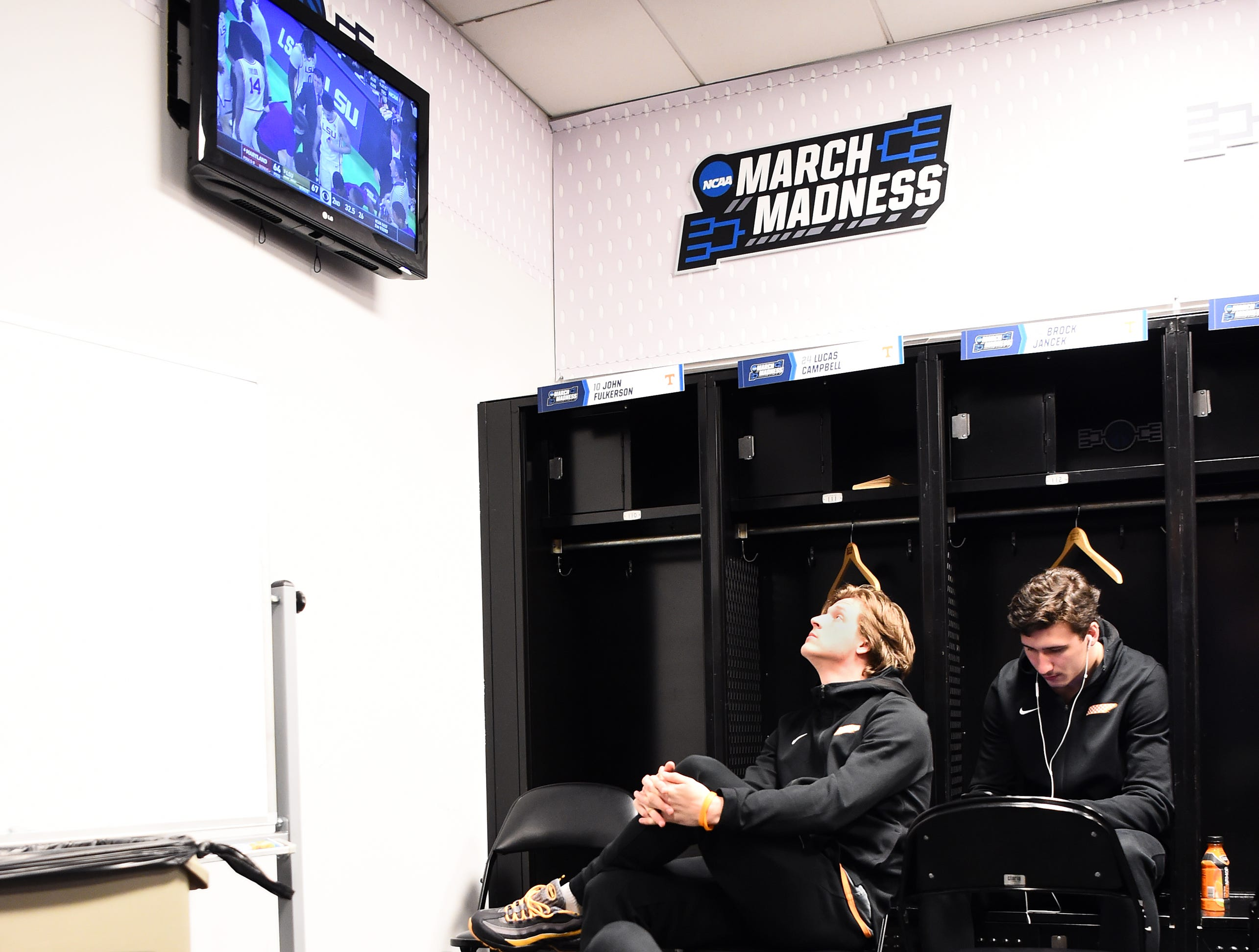 The Tennessee locker room watches the final seconds of the LSU-Maryland second game NCAA Tournament game during media availability on Saturday, March 23, 2019.