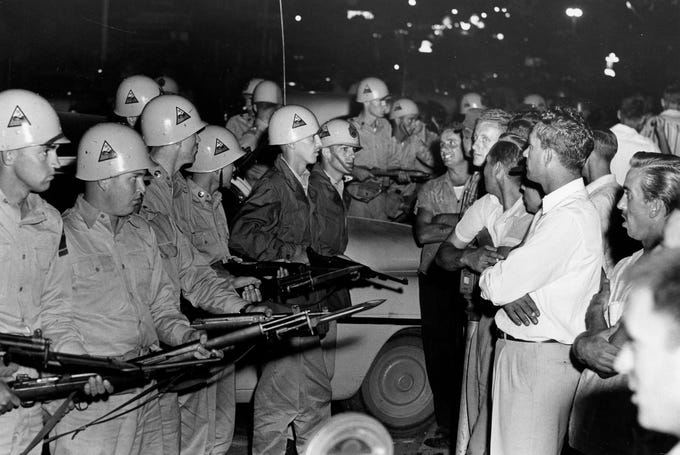 National Guardsmen control jeering citizens in Clinton just after a court order to integrate Clinton High School. Dated: Sep. 3, 1956.