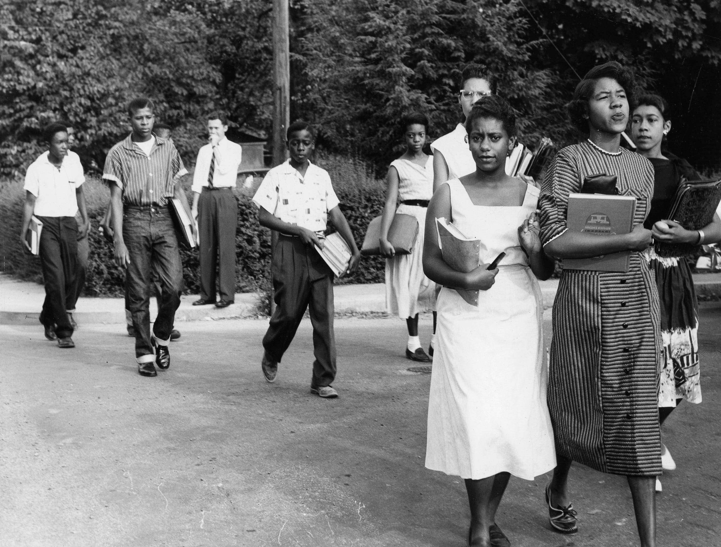 Ten of the 12 African-American students attendign Clinton High school in 1956 walk from their nearby homes to classes. Dated: Sep. 6, 1956.