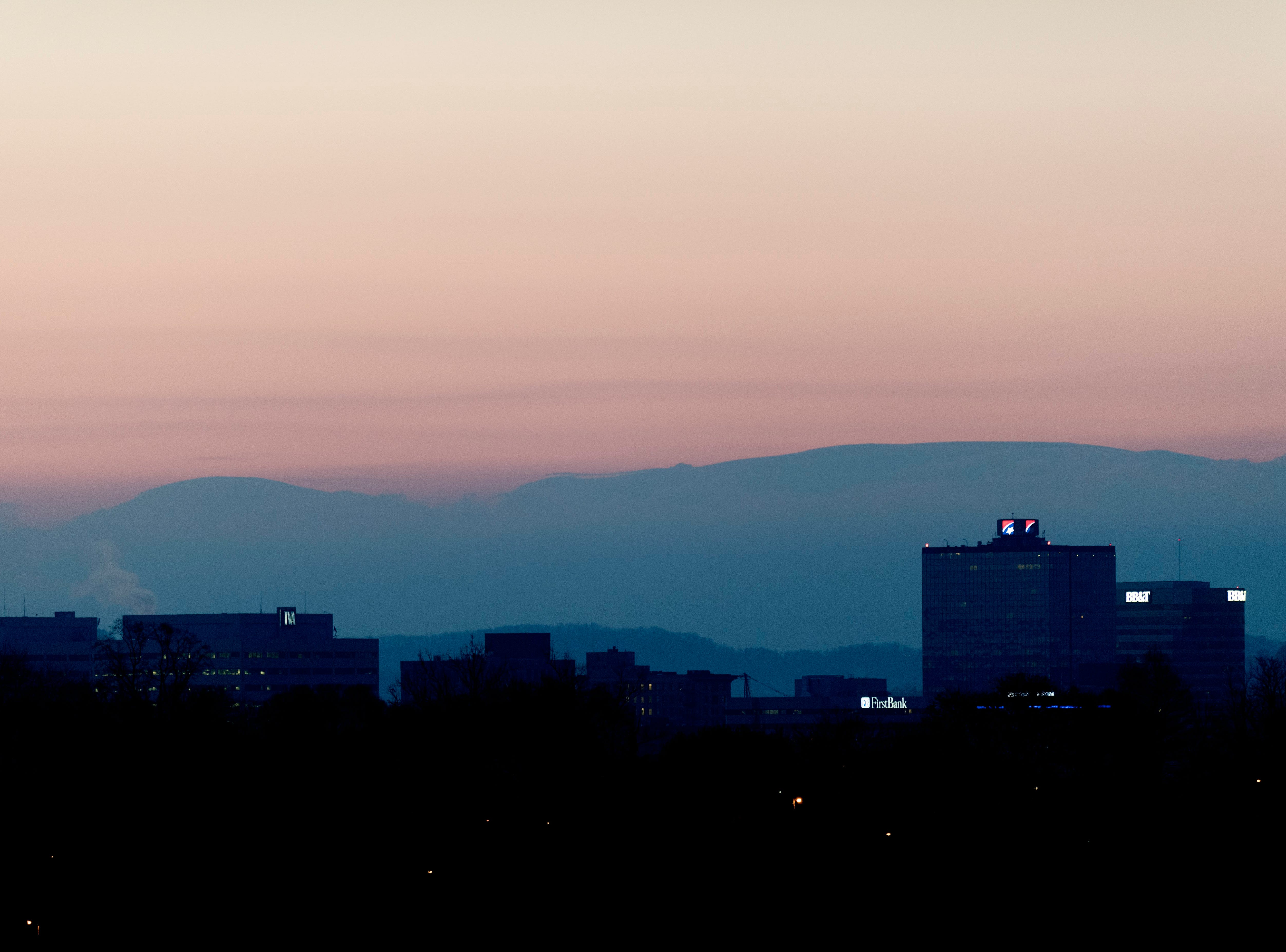 Knoxville skyline with the Smoky Mountains seen in the background.