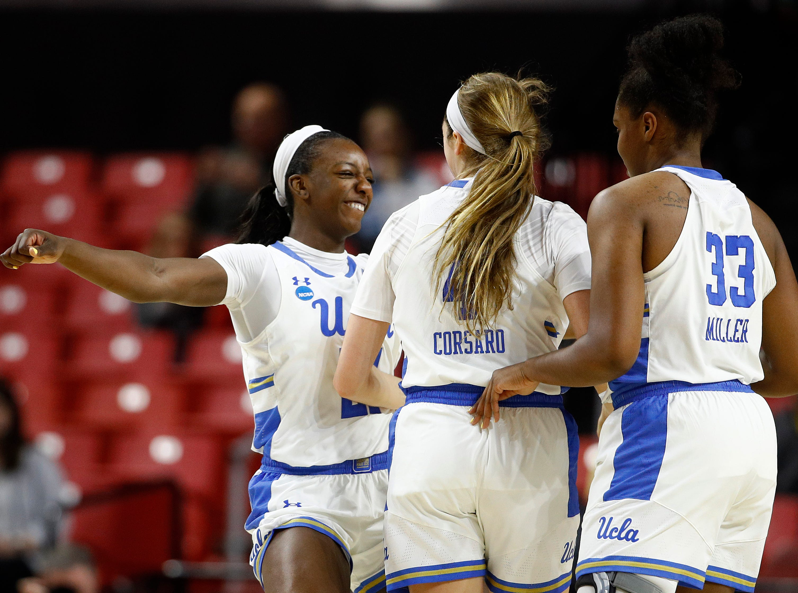 UCLA forward Michaela Onyenwere, left, celebrates with teammates Lindsey Corsaro and Lauryn Miller after Corsaro scored and Tennessee called a timeout in the first half of first-round game in the NCAA women's college basketball tournament, Saturday, March 23, 2019, in College Park, Md. UCLA won 89-77.
