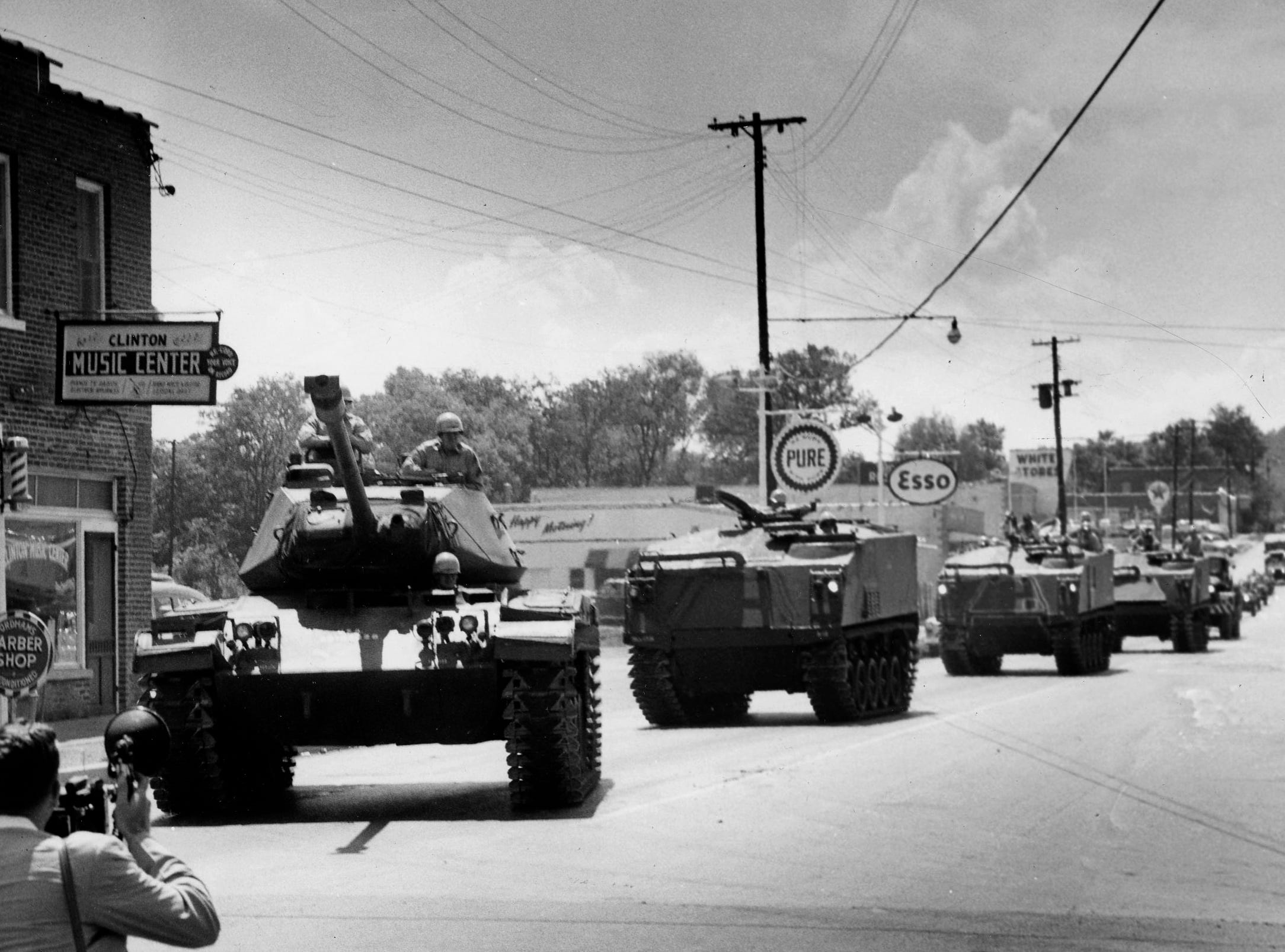 National Guard tanks and recon vehicles swoop down on this riot torn East Tennessee Town as Gov. Frank Clement ordered the guard troops in to put an end to the anti-integration rioting which has taken place here for the past two nights. Dated: Sep. 2, 1956.