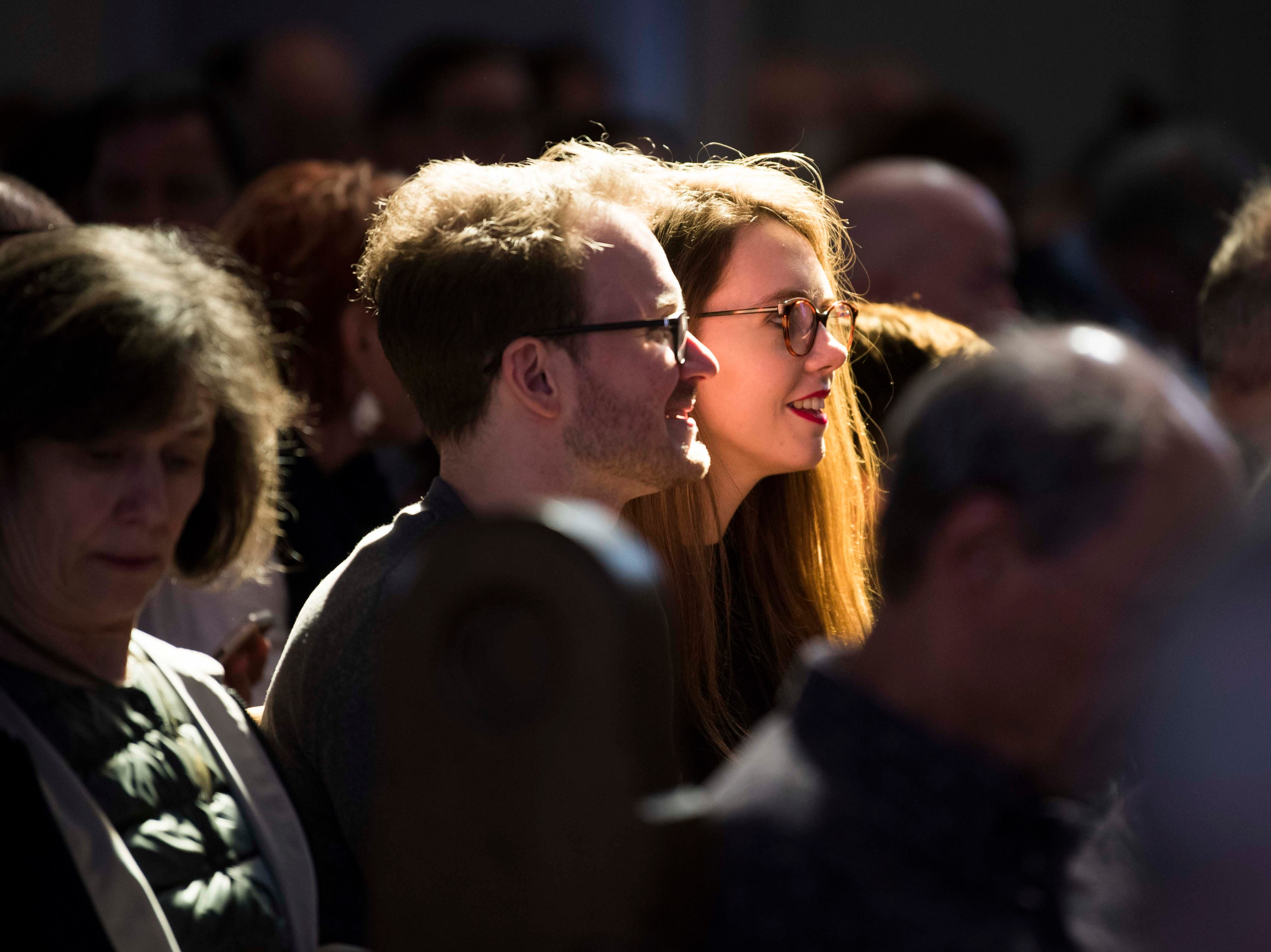 Attendees sit in light  at St. John's Episcopal Cathedral before listening to the Shai Maestro Trio during Big Ears Music Festival in downtown Knoxville Friday, March 22, 2019.