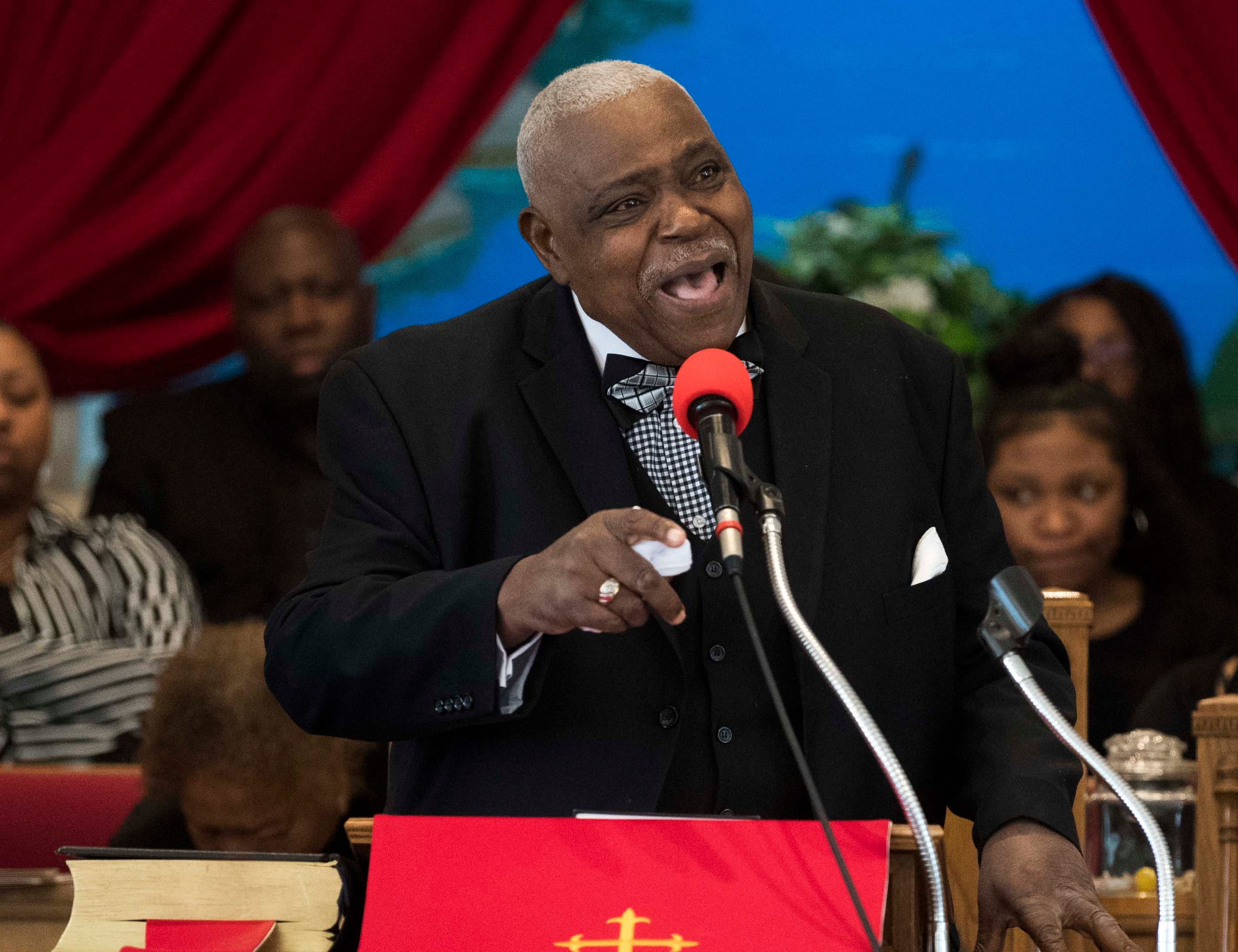 Pastor William A. Caldwell, Jr. gives the eulogy at the funeral of Alfred Williams at Mt. Sinai Baptist Church in Clinton, Saturday, March 23, 2019. Williams was one of the Clinton 12, who were the first students to desegregate Clinton High School in 1956.