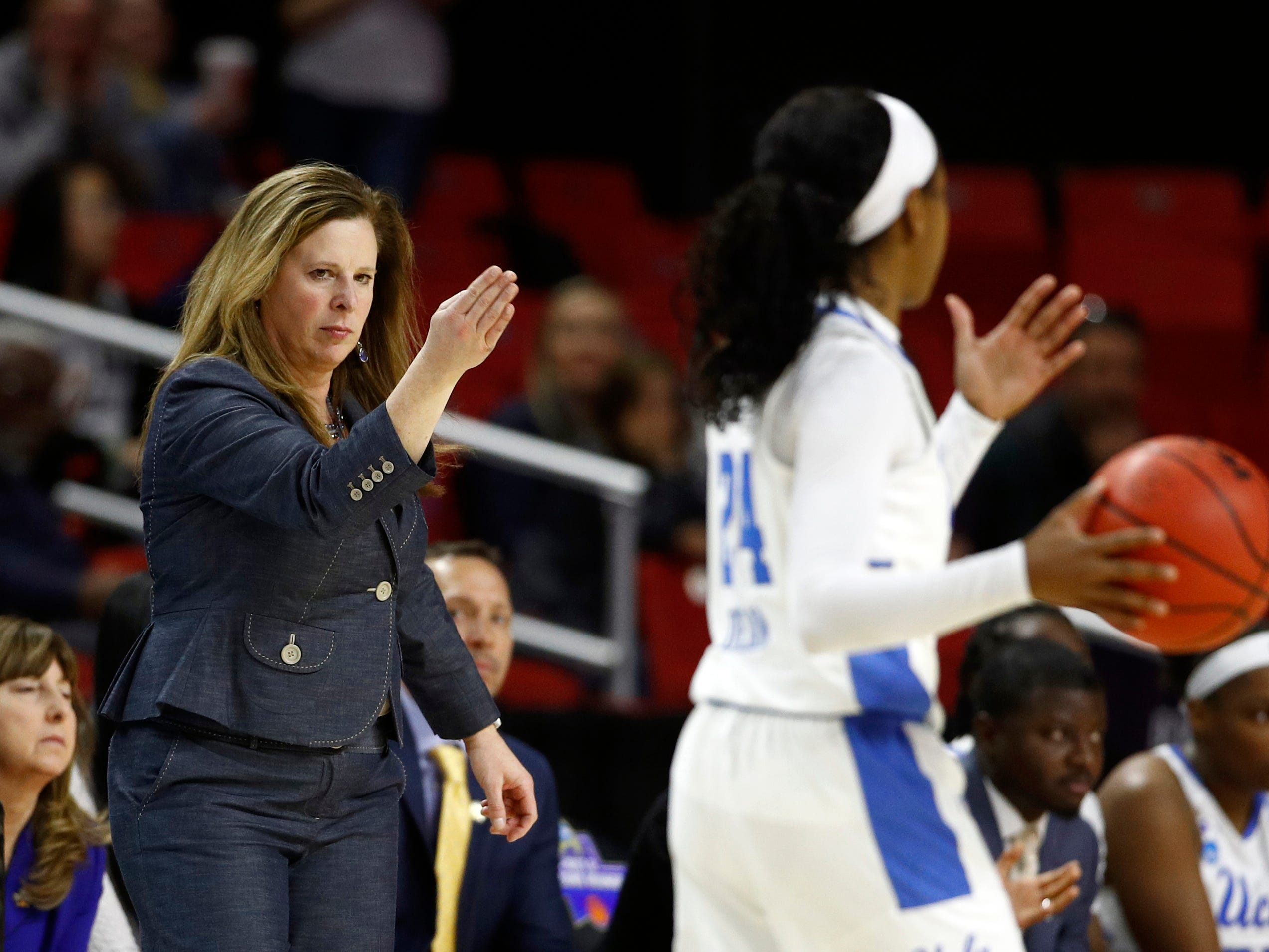 UCLA head coach Cori Close, left, directs guard Japreece Dean in the second half of a first-round game against Tennessee in the NCAA women's college basketball tournament, Saturday, March 23, 2019, in College Park, Md.