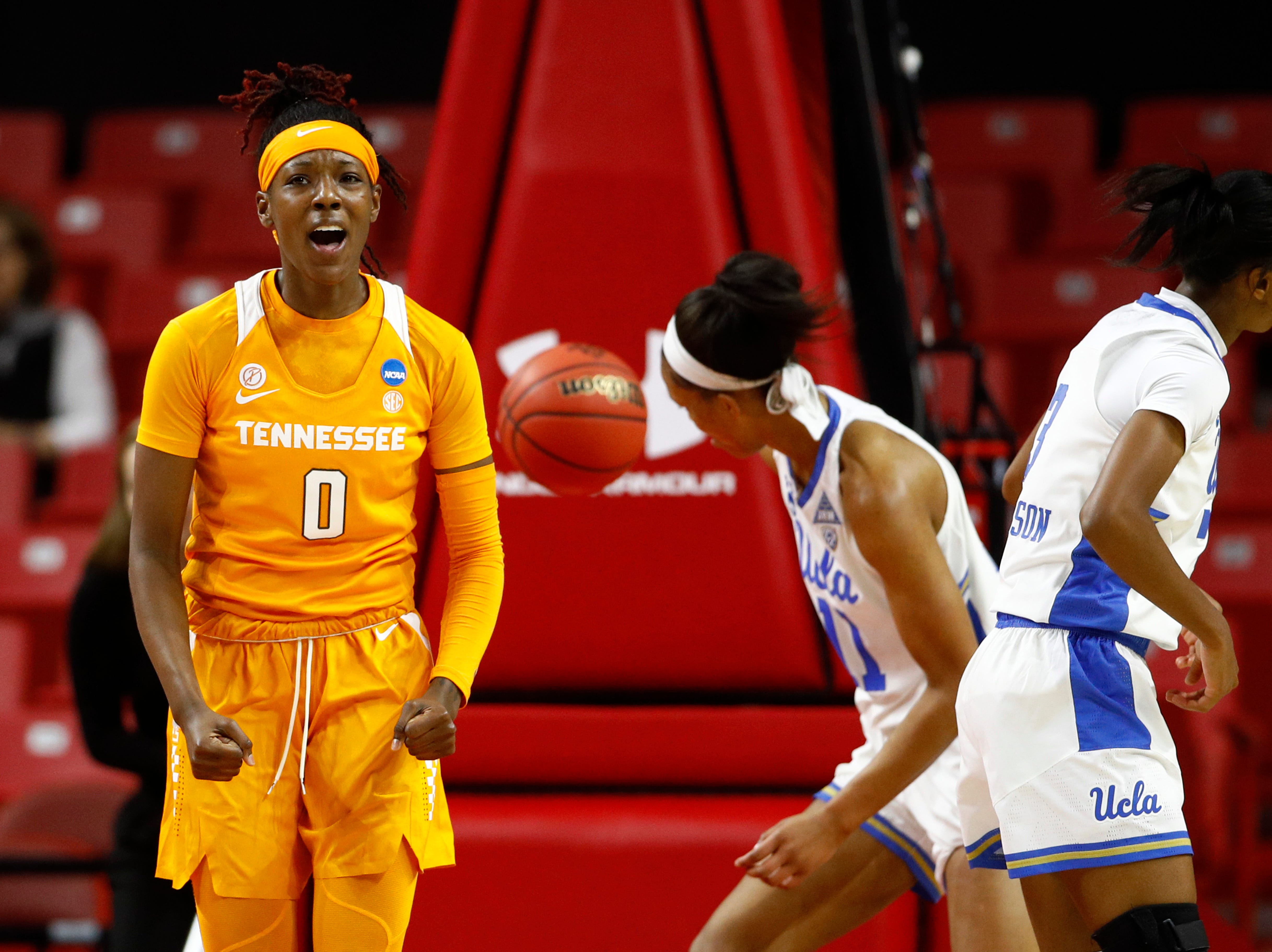 Tennessee guard Rennia Davis (0) reacts after scoring in the first half of a first-round game against UCLA in the NCAA women's college basketball tournament, Saturday, March 23, 2019, in College Park, Md.