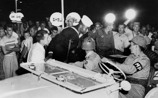 James Chandler, a 19-year-old Knoxville sailor, is recured from a mob of racists by Tennessee national guardsmen. The mob had Chandler cornered in a filling station on the edge of town. He had come to Clinton to visit his girlfriend when he was spotted by the mob.