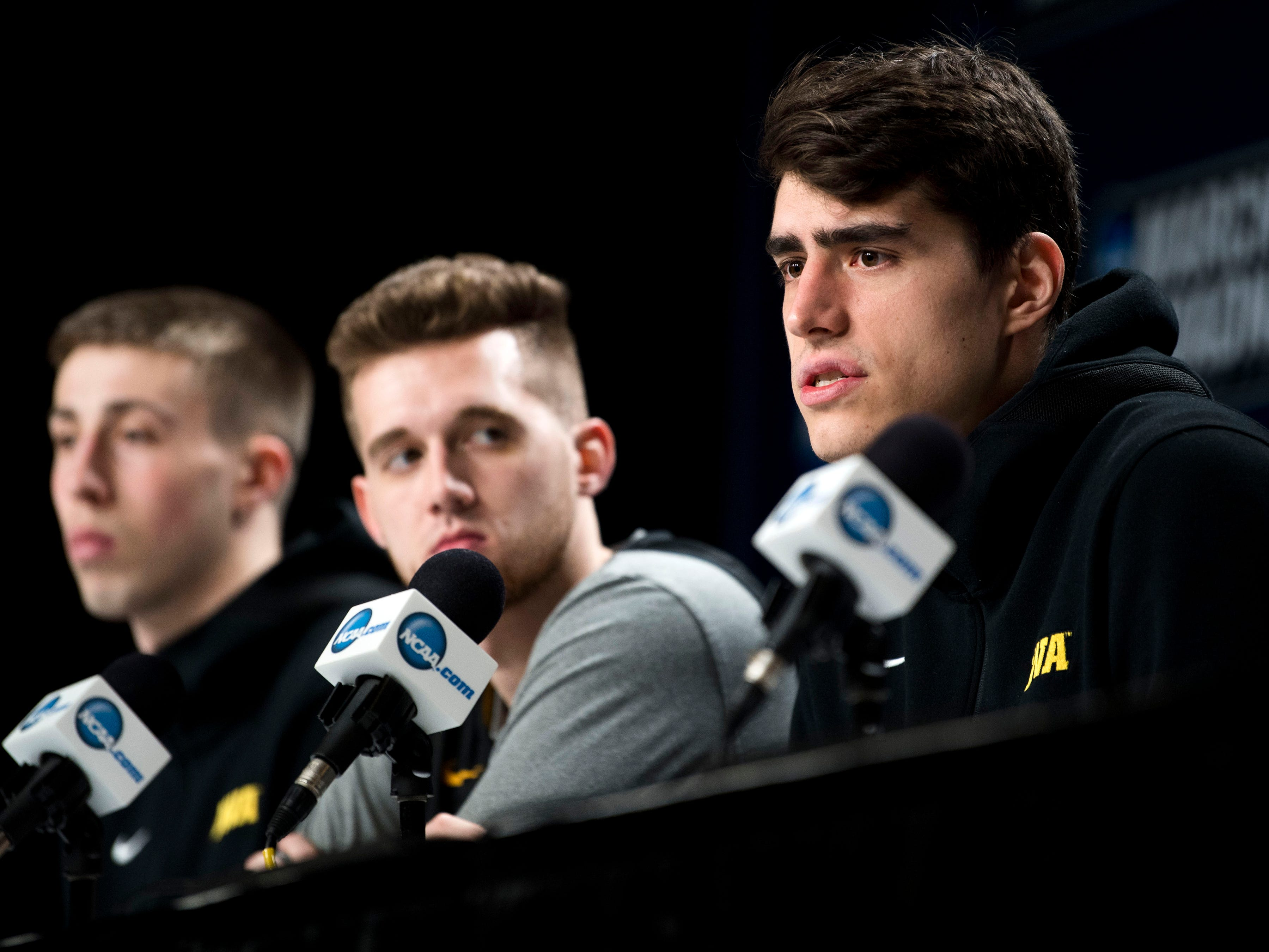 Iowa's Luka Garza, right, speaks at a press conference on Saturday, March 23, 2019, before the Tennessee Volunteers and Iowa Hawkeyes compete against one another in the second round of the NCAA Tournament held at Nationwide Arena in Columbus, Ohio on Sunday, March 24, 2019.
