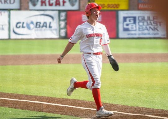 UL shortstop Hayden Cantrelle lets out a holler before scoring in the Ragin' Cajuns' 7-4 win over Appalachian State on Saturday. Cantrelle extended his hitting streak to 12 consecutive games  in the victory.