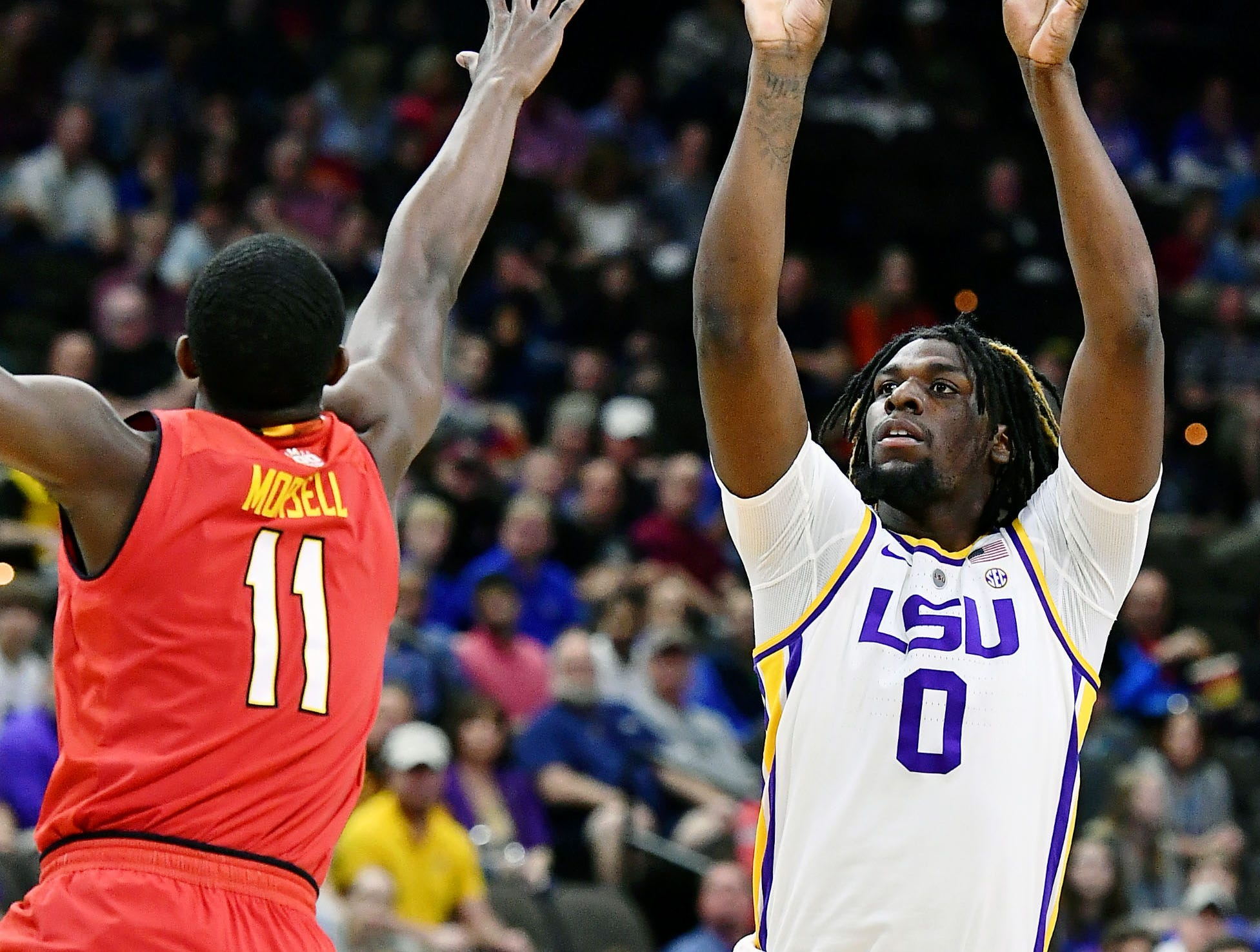 Mar 23, 2019; Jacksonville, FL, USA; LSU Tigers forward Naz Reid (0) shoots while defended by Maryland Terrapins guard Darryl Morsell (11) during the first half in the second round of the 2019 NCAA Tournament at Jacksonville Veterans Memorial Arena. Mandatory Credit: John David Mercer-USA TODAY Sports