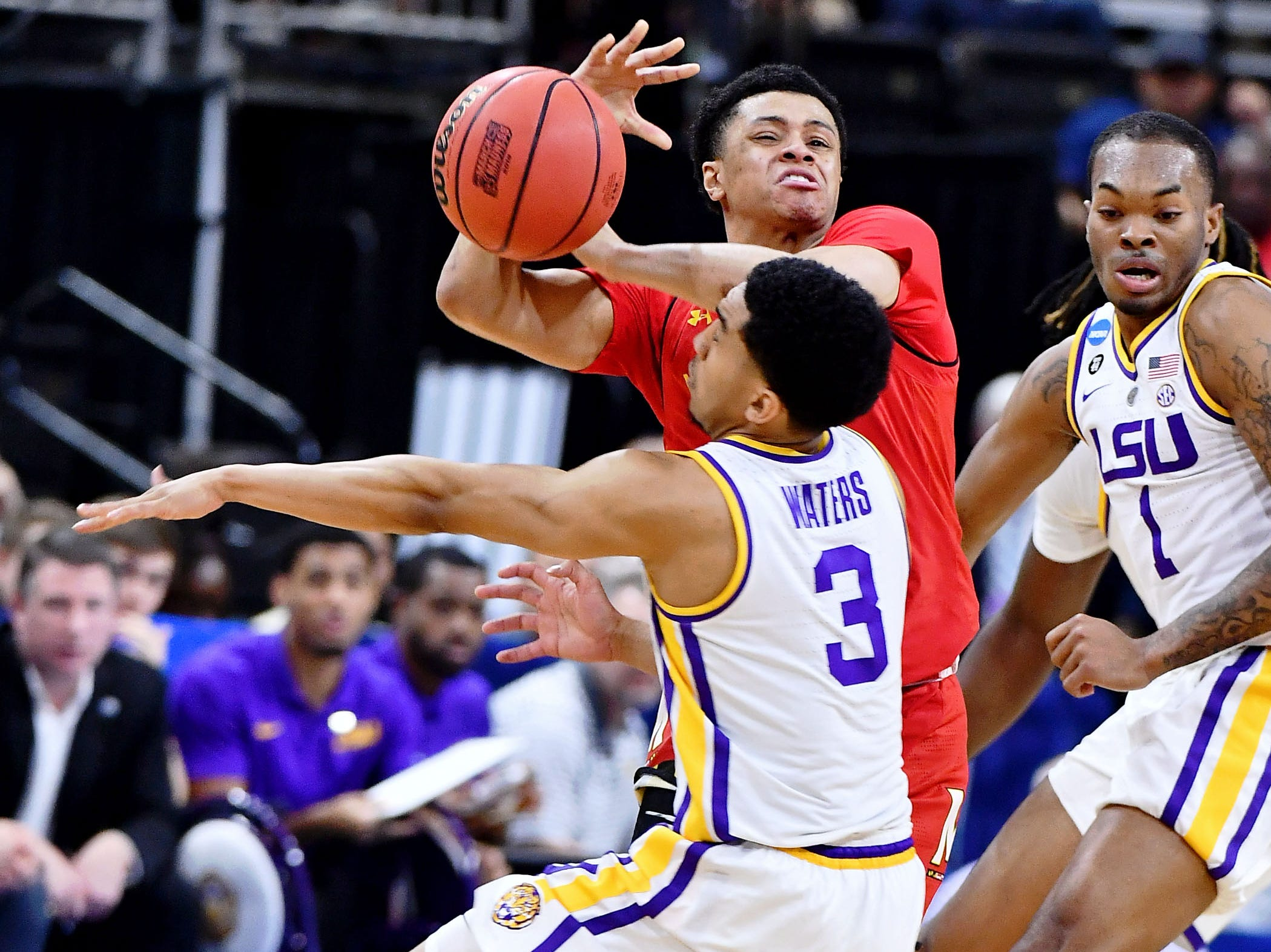 Mar 23, 2019; Jacksonville, FL, USA; LSU Tigers guard Tremont Waters (3) attempts to steal the ball from Maryland Terrapins guard Anthony Cowan Jr. (1) during the first half in the second round of the 2019 NCAA Tournament at Jacksonville Veterans Memorial Arena. Mandatory Credit: John David Mercer-USA TODAY Sports