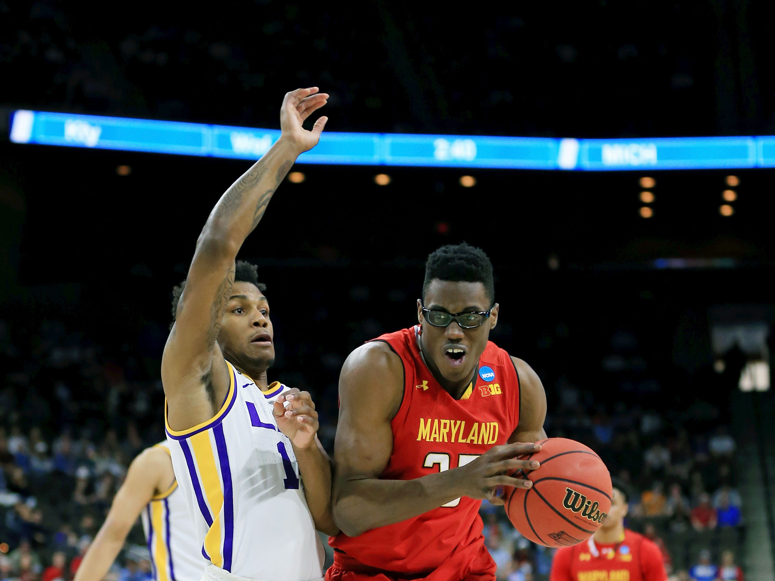 Mar 23, 2019; Jacksonville, FL, USA; Maryland Terrapins forward Jalen Smith (25) dribbles around LSU Tigers guard Javonte Smart (1) during the first half in the second round of the 2019 NCAA Tournament at Jacksonville Veterans Memorial Arena. Mandatory Credit: Matt Stamey-USA TODAY Sports