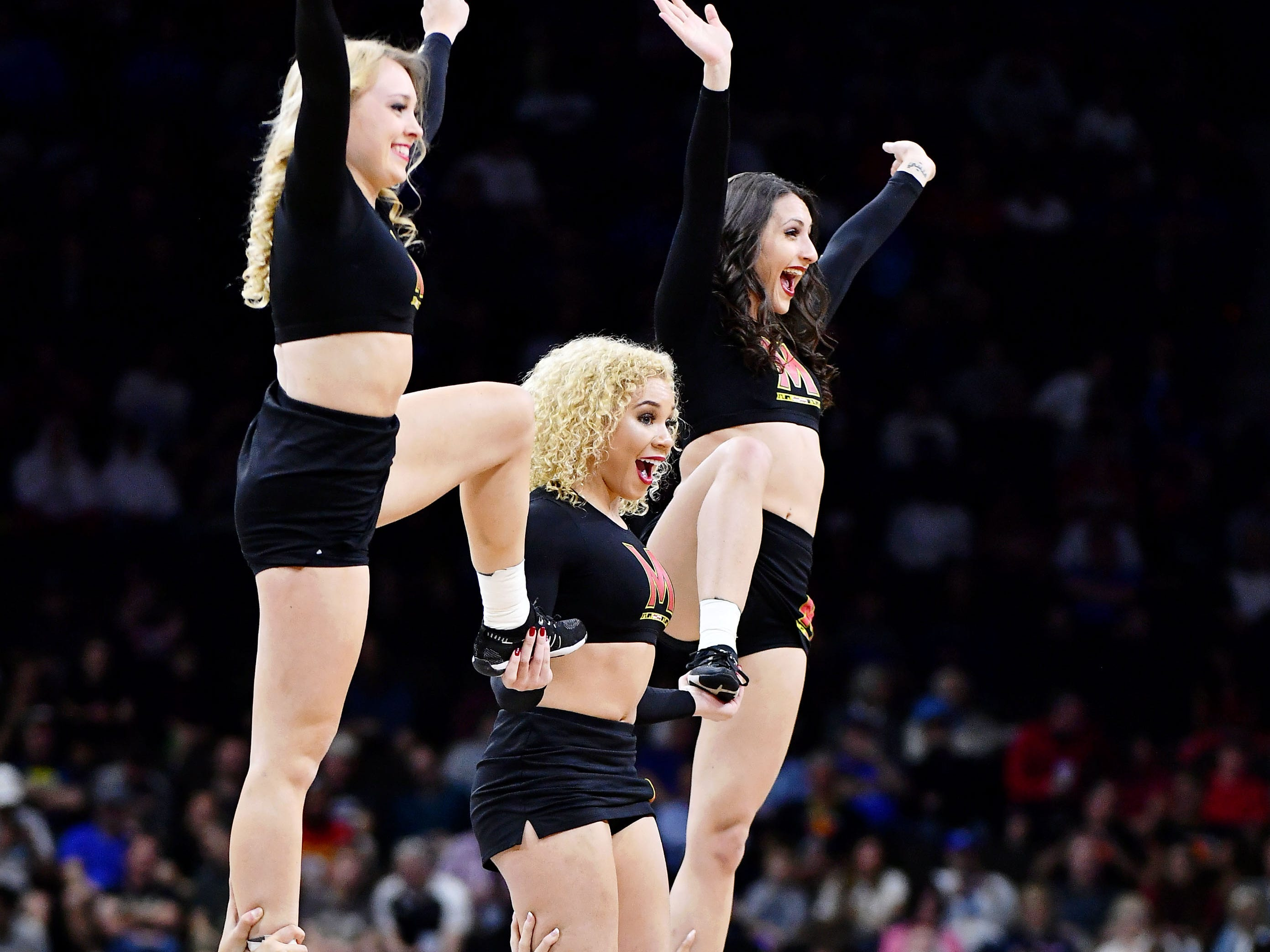 Mar 23, 2019; Jacksonville, FL, USA; The Maryland Terrapins cheerleaders perform during a timeout during the first half of their game against the LSU Tigers in the second round of the 2019 NCAA Tournament at Jacksonville Veterans Memorial Arena. Mandatory Credit: John David Mercer-USA TODAY Sports