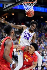 LSU Tigers forward Emmitt Williams lands on Maryland Terrapins forward Ricky Lindo Jr. after making a basket during the first half in the second round of the 2019 NCAA Tournament at Jacksonville Veterans Memorial Arena.