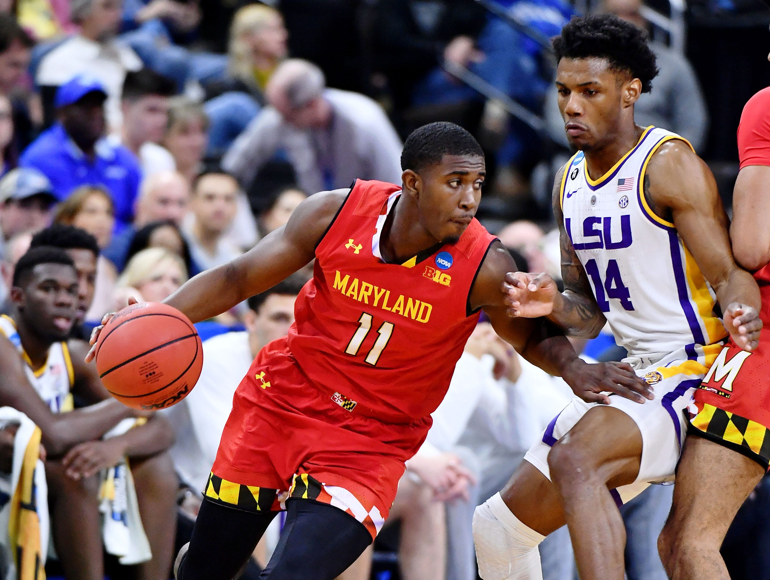 Mar 23, 2019; Jacksonville, FL, USA; Maryland Terrapins guard Darryl Morsell (11) dribbles while defended by LSU Tigers guard Marlon Taylor (14) during the first half in the second round of the 2019 NCAA Tournament at Jacksonville Veterans Memorial Arena. Mandatory Credit: John David Mercer-USA TODAY Sports