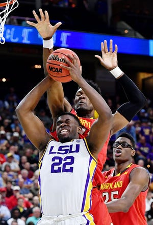 Mar 23, 2019; Jacksonville, FL, USA; LSU Tigers forward Darius Days (22) goes up to shoot while defended by Maryland Terrapins forward Bruno Fernando (23) during the first half in the second round of the 2019 NCAA Tournament at Jacksonville Veterans Memorial Arena. Mandatory Credit: John David Mercer-USA TODAY Sports