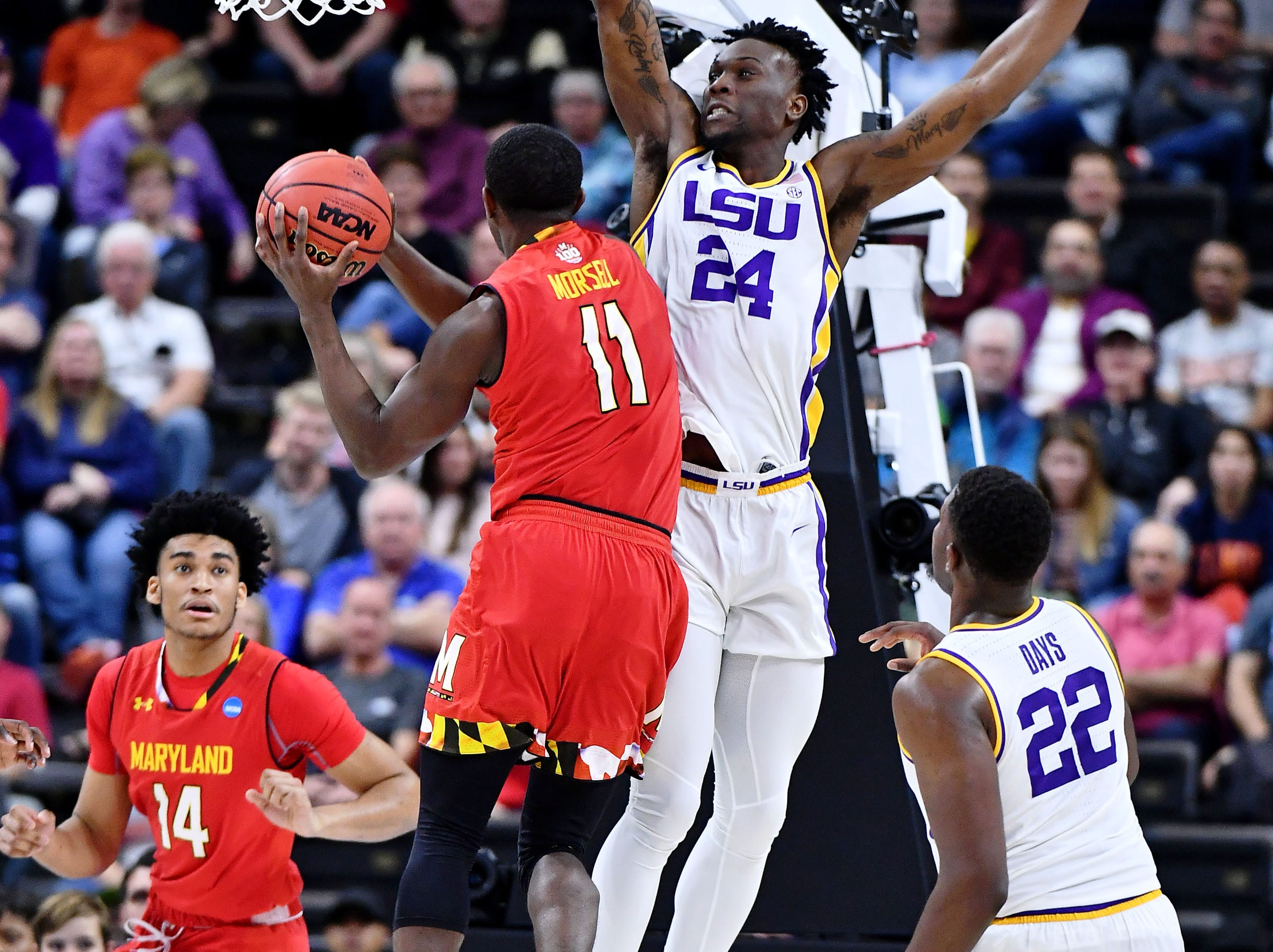 LSU Tigers forward Emmitt Williams jumps up to block Maryland Terrapins guard Darryl Morsell during the first half in the second round of the 2019 NCAA Tournament at Jacksonville Veterans Memorial Arena.