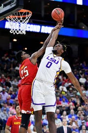 Mar 23, 2019; Jacksonville, FL, USA; LSU Tigers forward Naz Reid (0) shoots against and is fouled by Maryland Terrapins forward Jalen Smith (25) during the first half in the second round of the 2019 NCAA Tournament at Jacksonville Veterans Memorial Arena. Mandatory Credit: John David Mercer-USA TODAY Sports