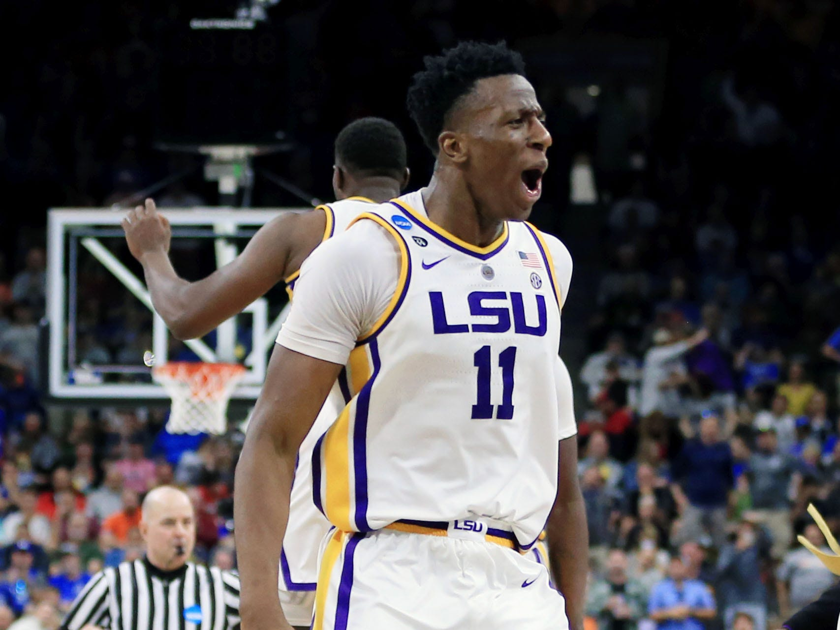 Mar 23, 2019; Jacksonville, FL, USA; LSU Tigers forward Kavell Bigby-Williams (11) celebrates their win over Maryland Terrapins in the second round of the 2019 NCAA Tournament at Jacksonville Veterans Memorial Arena. The LSU Tigers won 69-67. Mandatory Credit: Matt Stamey-USA TODAY Sports