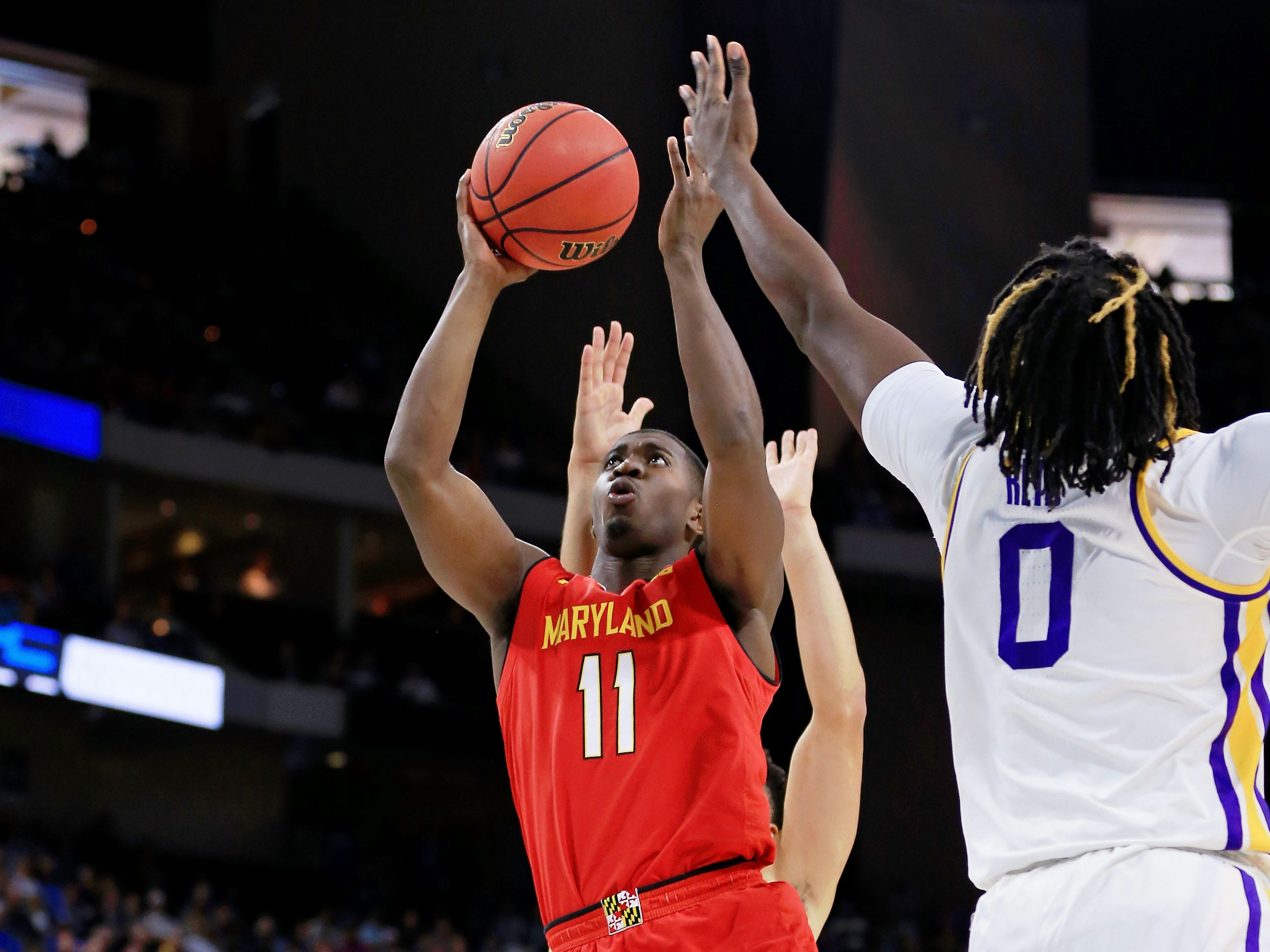Mar 23, 2019; Jacksonville, FL, USA; Maryland Terrapins guard Darryl Morsell (11) shoots while LSU Tigers forward Naz Reid (0) attempts to block during the first half in the second round of the 2019 NCAA Tournament at Jacksonville Veterans Memorial Arena. Mandatory Credit: Matt Stamey-USA TODAY Sports