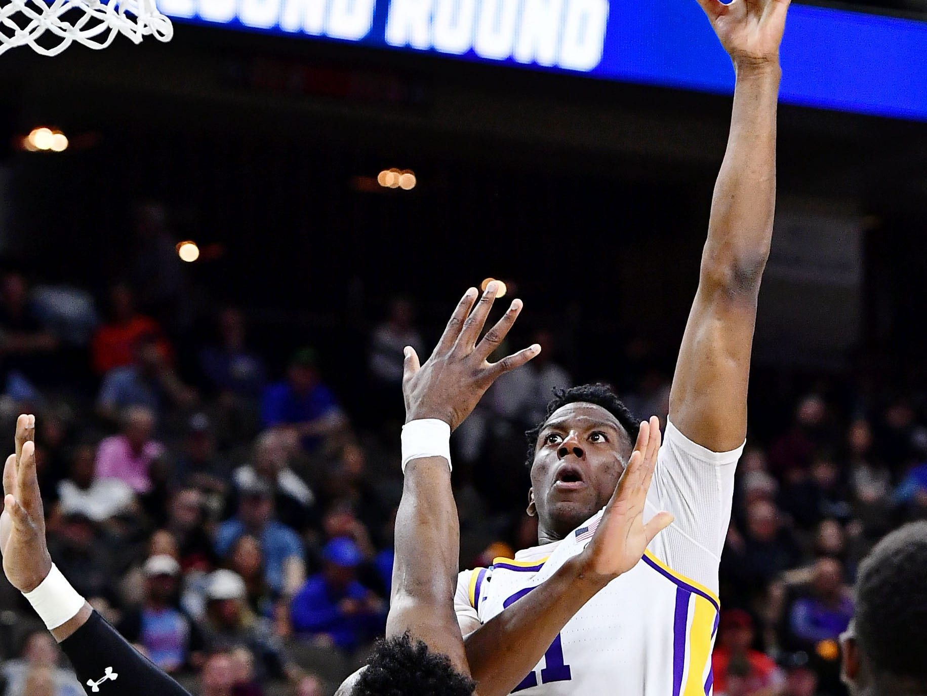 Mar 23, 2019; Jacksonville, FL, USA; LSU Tigers forward Kavell Bigby-Williams (11) shoots over the defense of Maryland Terrapins during the first half in the second round of the 2019 NCAA Tournament at Jacksonville Veterans Memorial Arena. Mandatory Credit: John David Mercer-USA TODAY Sports