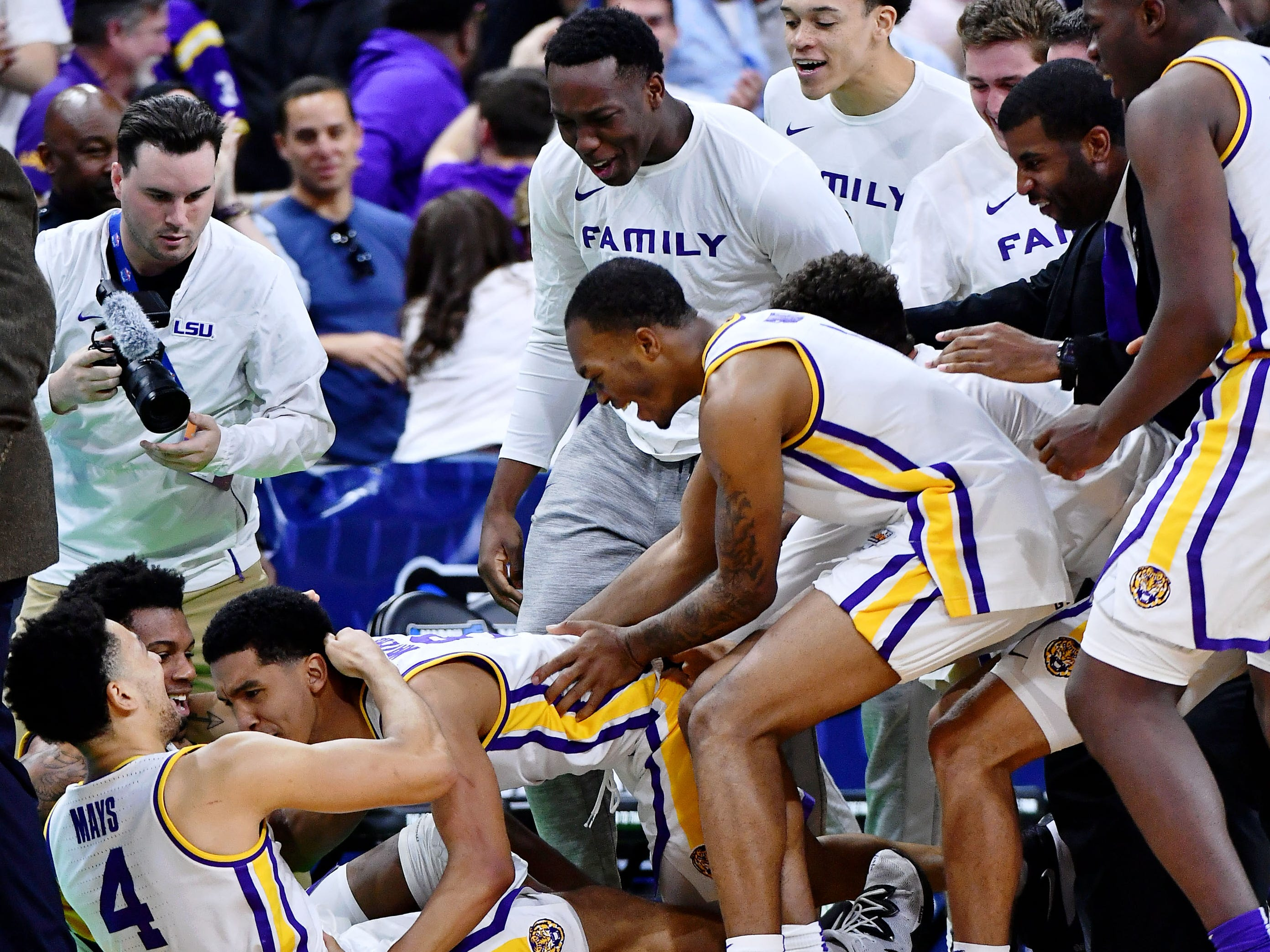 Mar 23, 2019; Jacksonville, FL, USA; The LSU Tigers celebrate their win over Maryland Terrapins in the second round of the 2019 NCAA Tournament at Jacksonville Veterans Memorial Arena. Mandatory Credit: The LSU Tigers won 69-67. John David Mercer-USA TODAY Sports