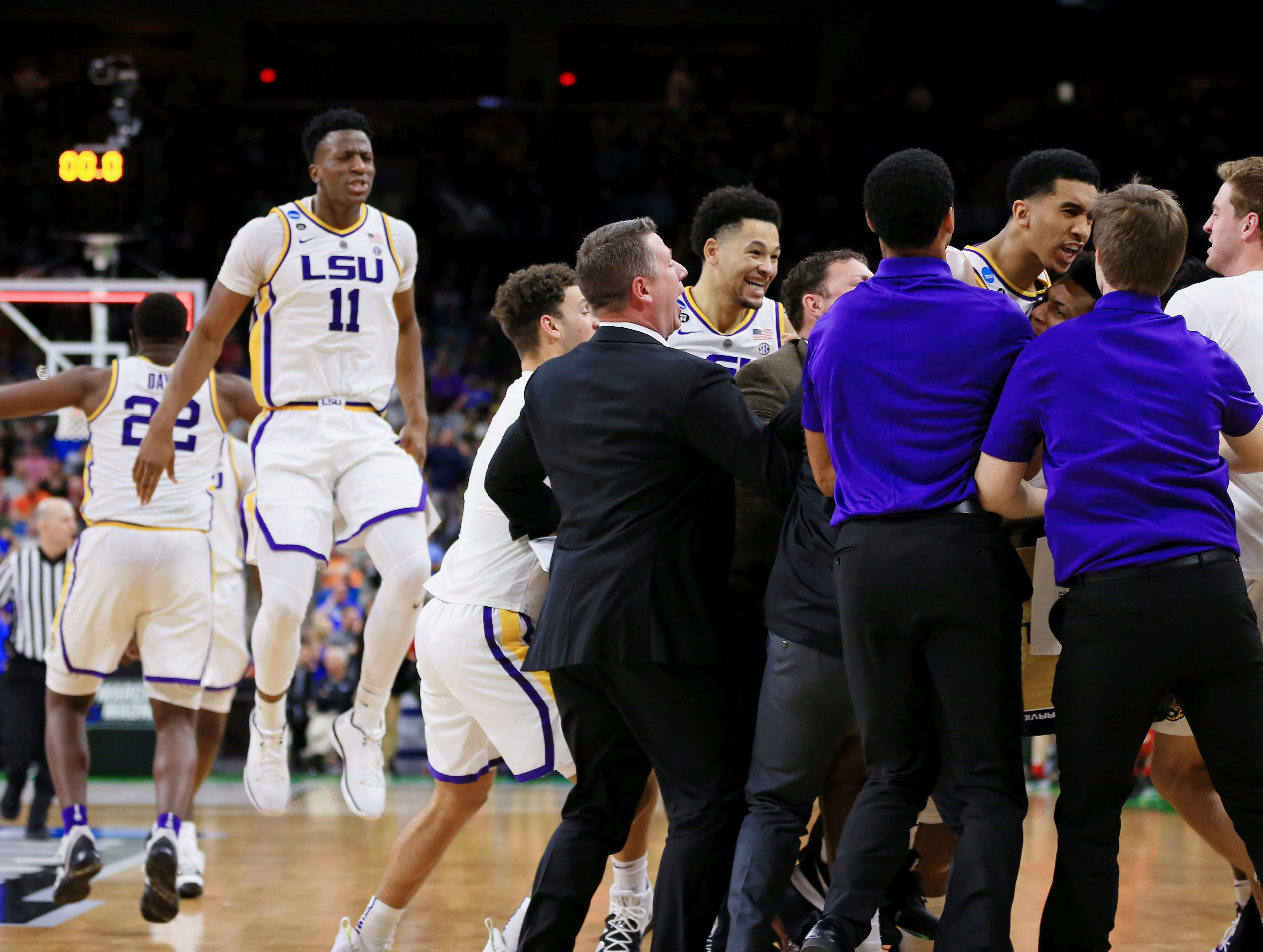 Mar 23, 2019; Jacksonville, FL, USA; The LSU Tigers celebrate their win over Maryland Terrapins in the second round of the 2019 NCAA Tournament at Jacksonville Veterans Memorial Arena. The LSU Tigers won 69-67. Mandatory Credit: Matt Stamey-USA TODAY Sports