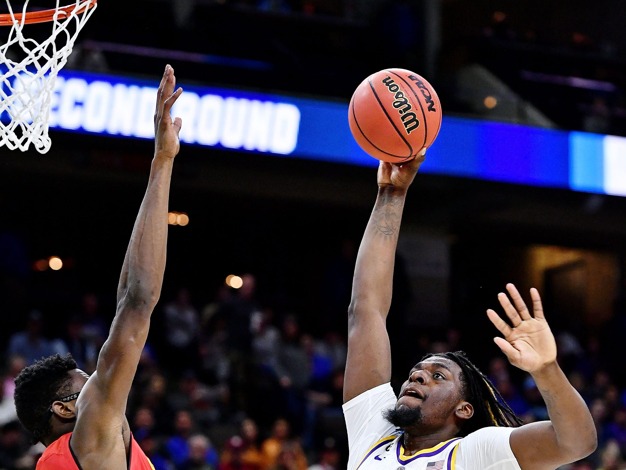 LSU Tigers forward Naz Reid (0) shoots against Maryland Terrapins forward Jalen Smith (25) during the first half in the second round of the 2019 NCAA Tournament at Jacksonville Veterans Memorial Arena.