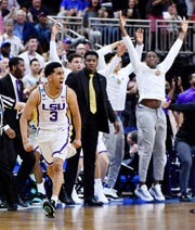 Mar 23, 2019; Jacksonville, FL, USA; LSU Tigers guard Tremont Waters (3) and the bench celebrate a basket against the Maryland Terrapins during the second half in the second round of the 2019 NCAA Tournament at Jacksonville Veterans Memorial Arena. Mandatory Credit: The LSU Tigers won 69-67. John David Mercer-USA TODAY Sports